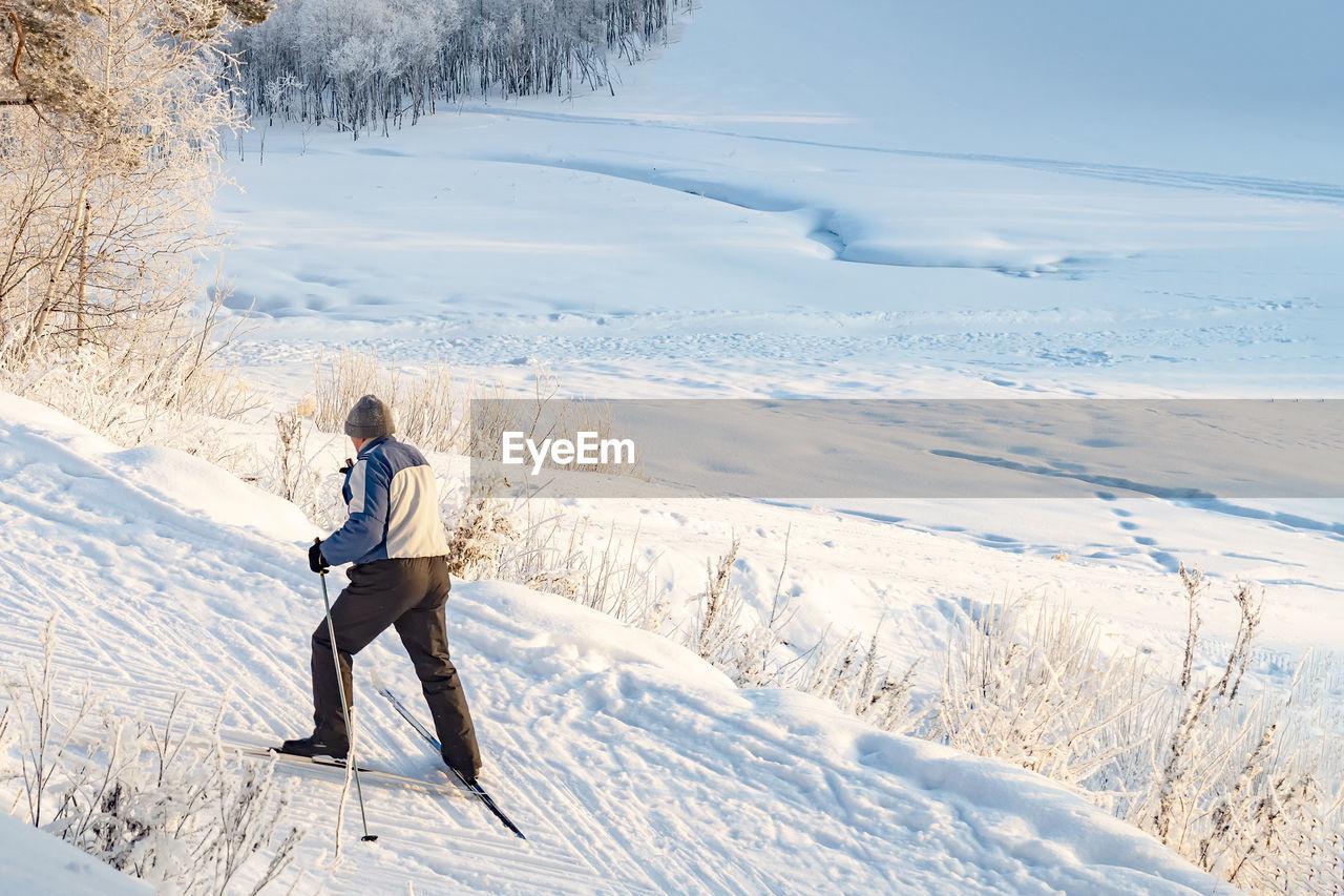 Full length of man on snowcapped field