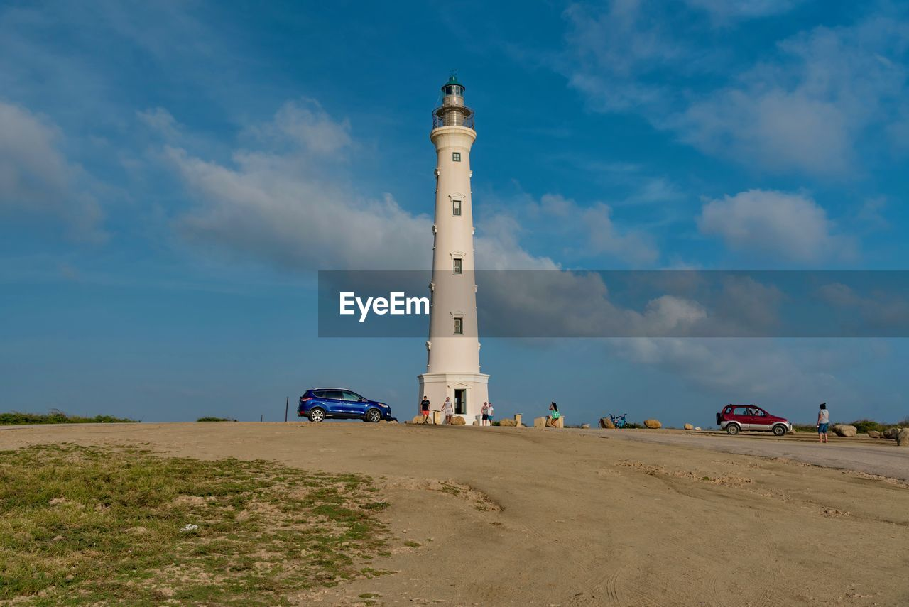 sky, built structure, tower, architecture, lighthouse, cloud - sky, building exterior, direction, land, nature, guidance, building, safety, security, mode of transportation, transportation, protection, no people, land vehicle, day, outdoors