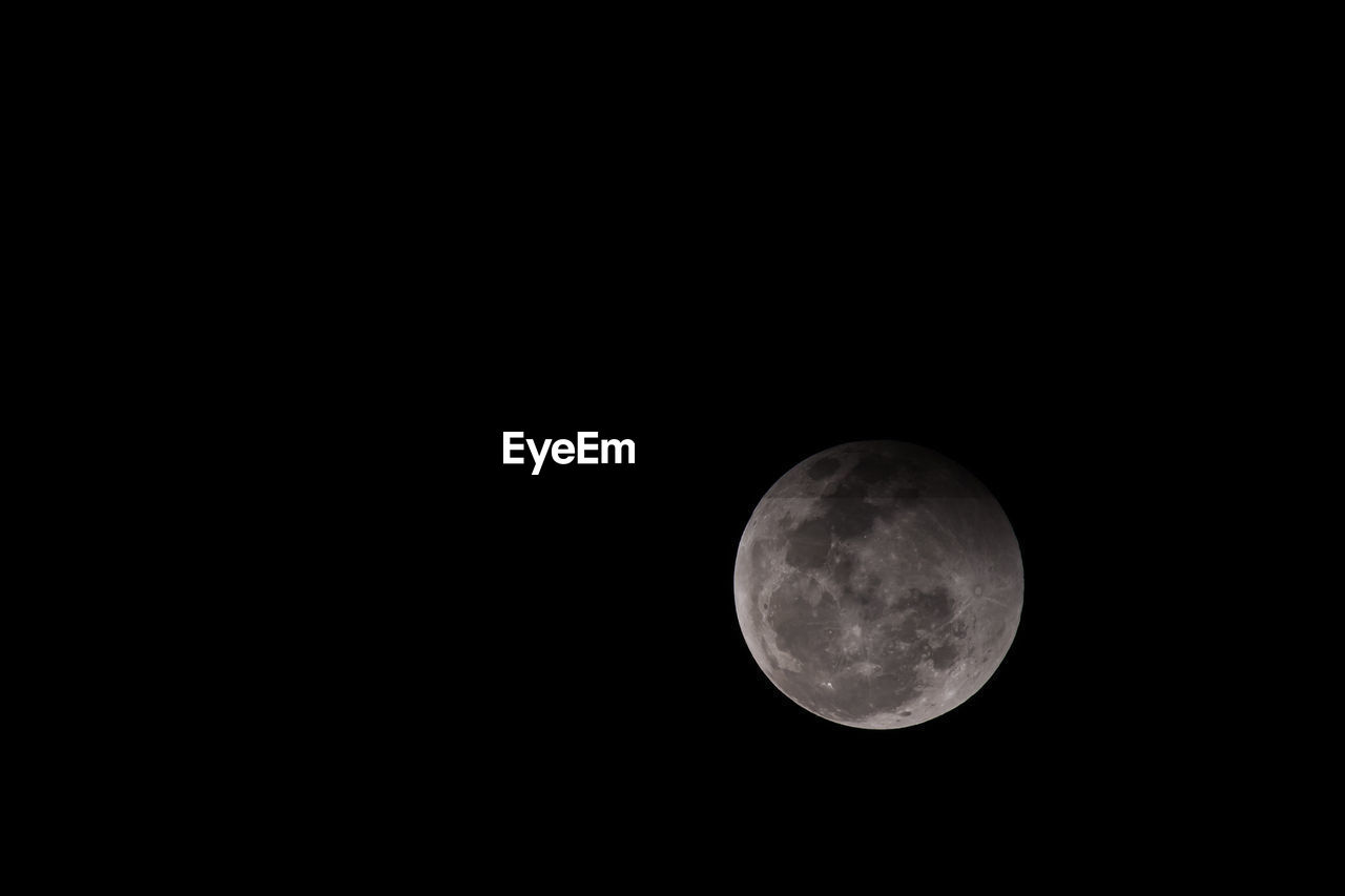 moon, astronomy, night, moon surface, beauty in nature, copy space, planetary moon, nature, no people, tranquility, scenics, low angle view, outdoors, clear sky, space exploration, space, sky
