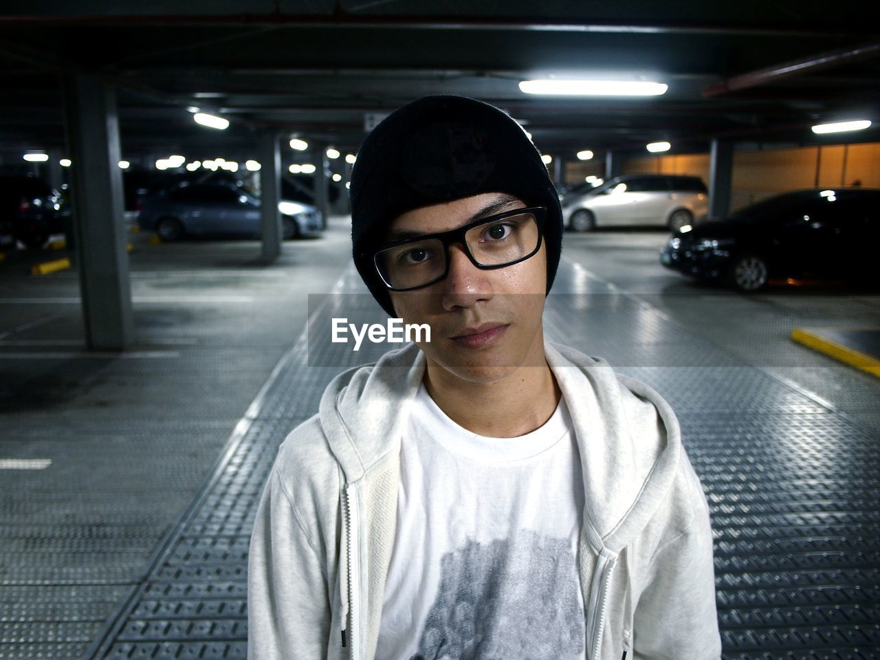Portrait of teenage boy standing in parking lot