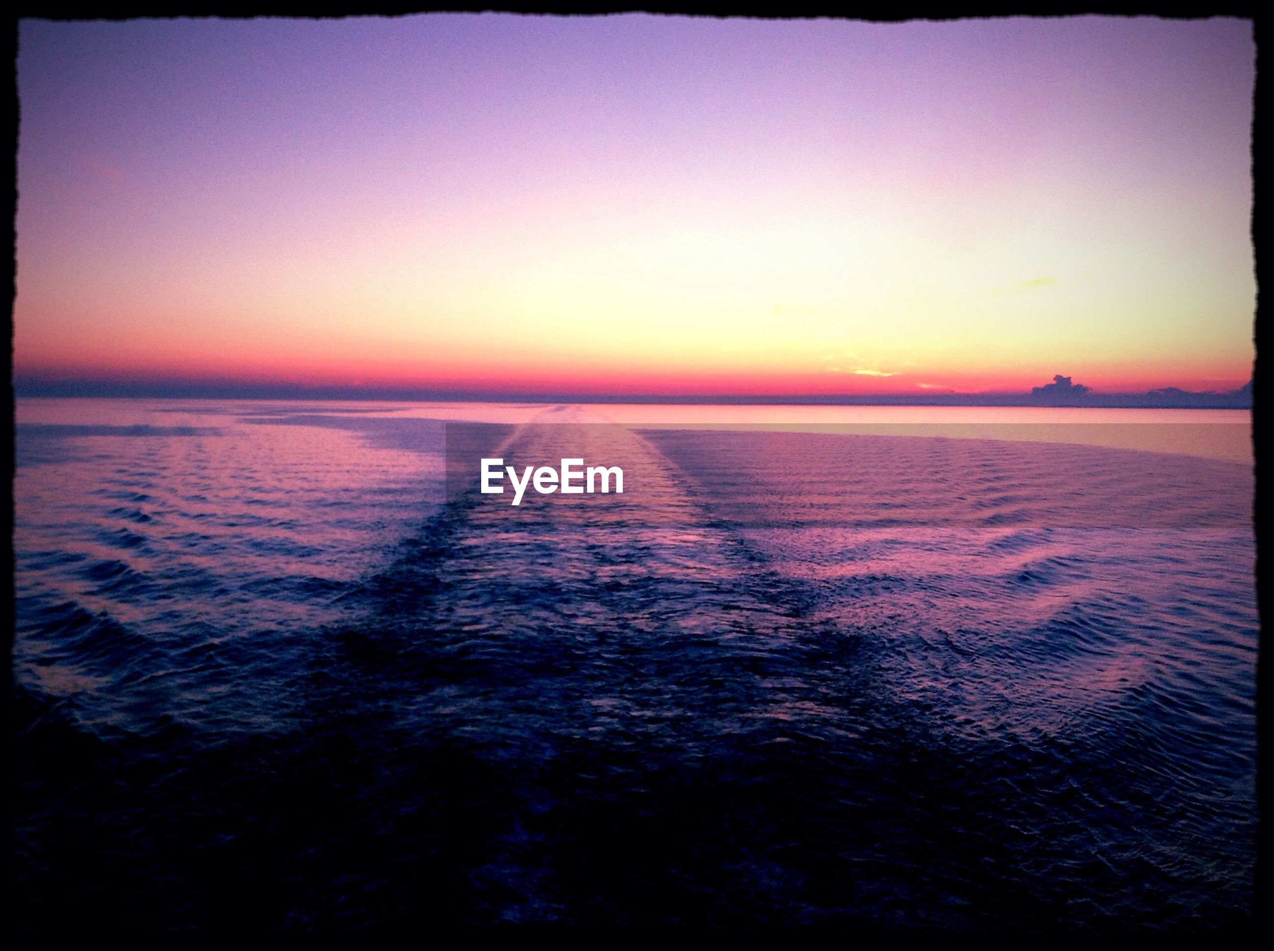 sunset, transfer print, water, sea, tranquil scene, auto post production filter, scenics, tranquility, beauty in nature, horizon over water, orange color, nature, sky, idyllic, clear sky, copy space, rippled, dusk, waterfront, outdoors