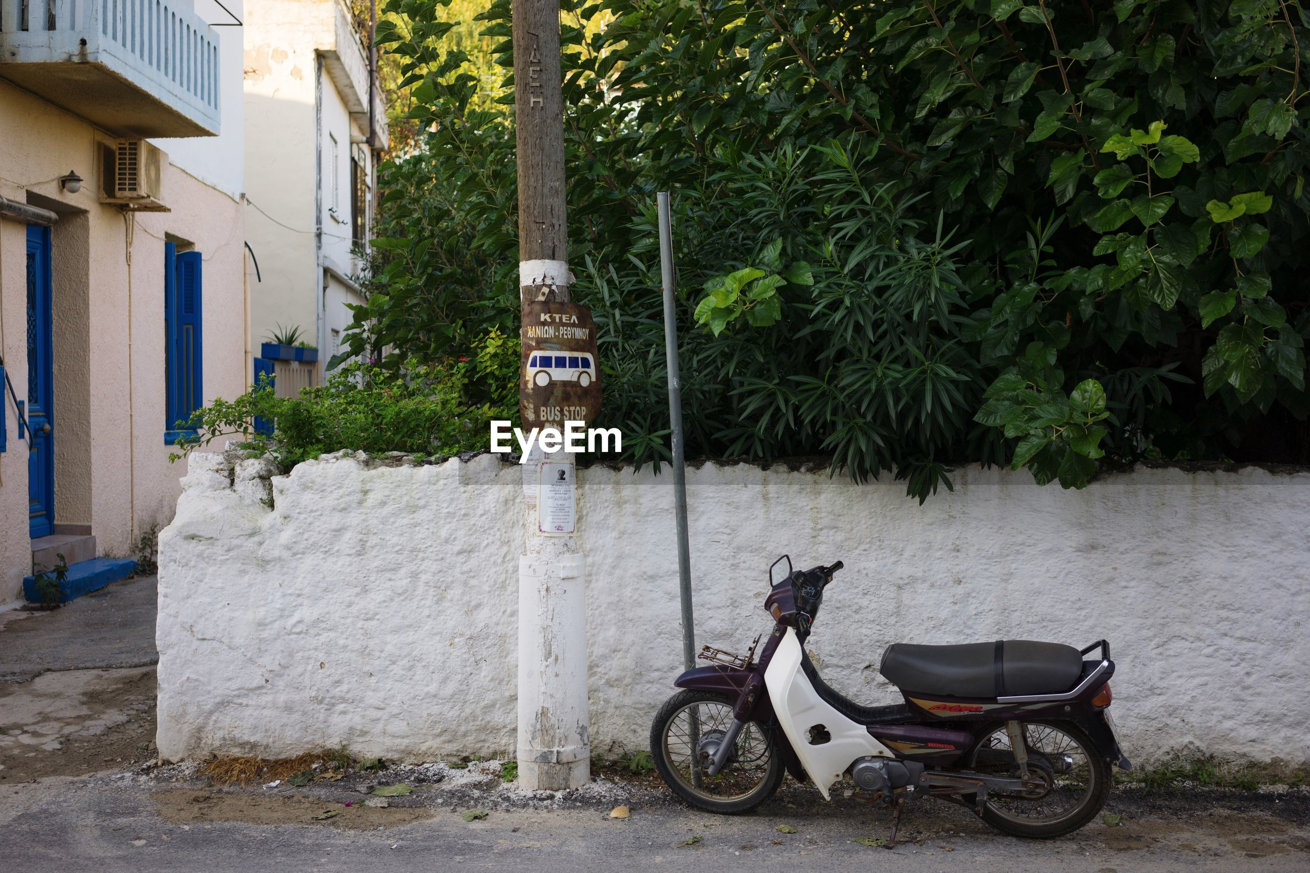 Motor scooter parked on footpath