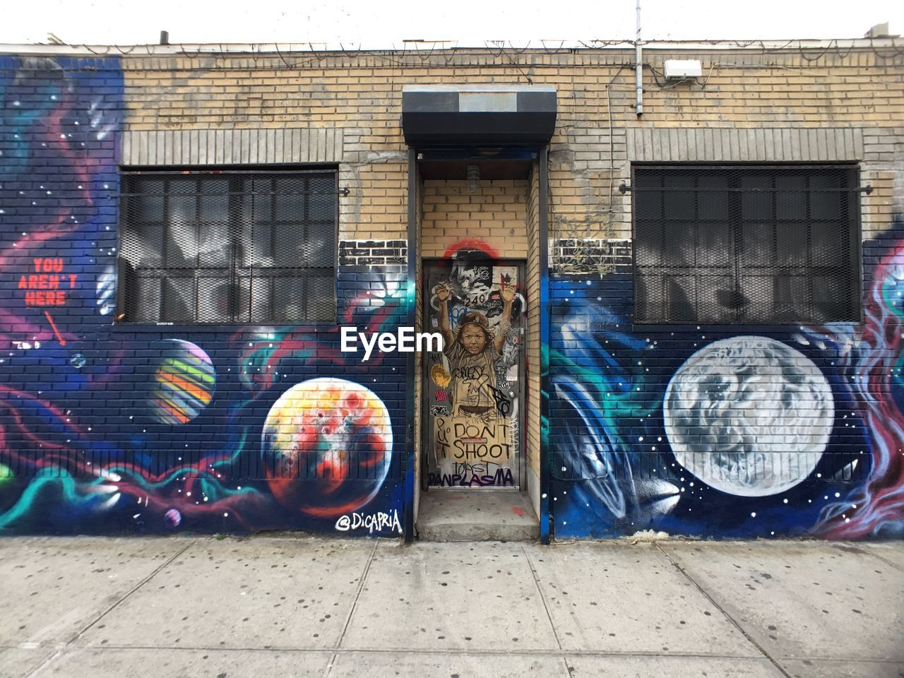 building exterior, architecture, built structure, creativity, art and craft, graffiti, multi colored, no people, building, city, day, outdoors, representation, transparent, human representation, street, wall - building feature, craft, wall, mural