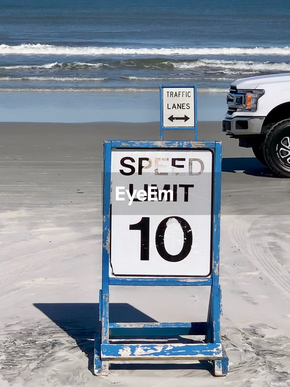 communication, text, western script, land, beach, sea, sign, number, nature, water, no people, snow, winter, day, sand, information sign, information, horizon, mode of transportation