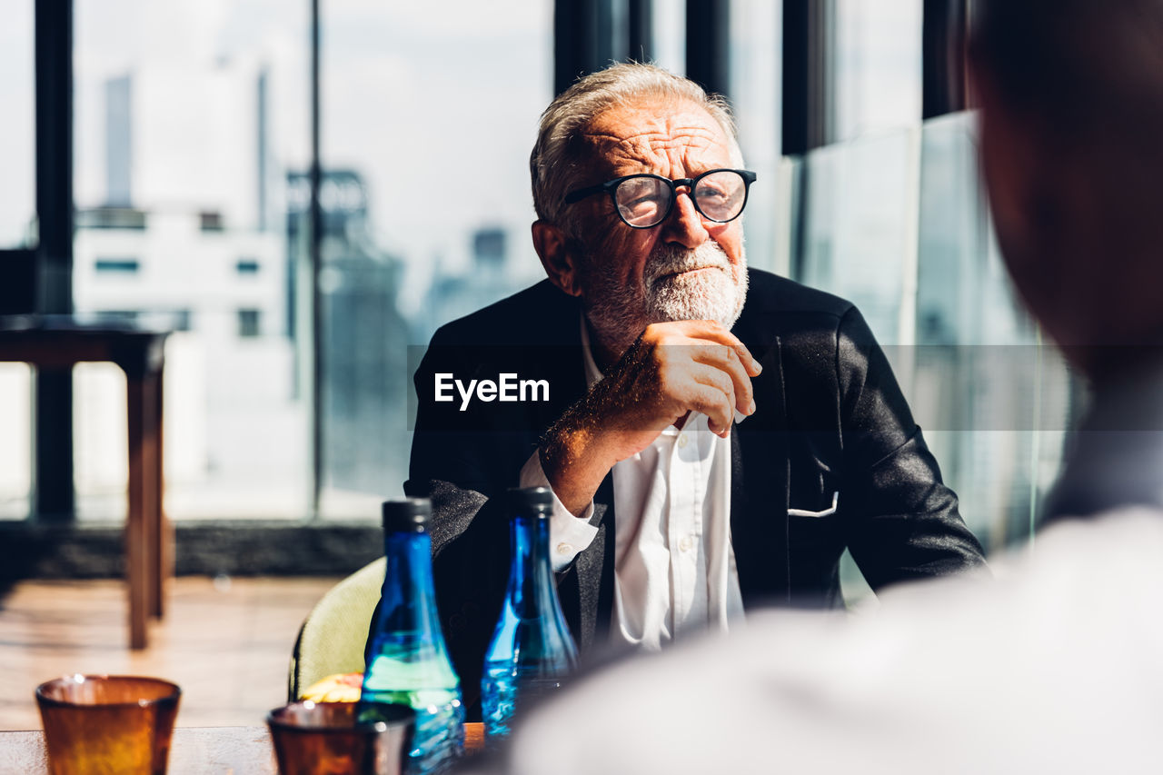 Senior man wearing eyeglasses sitting at office