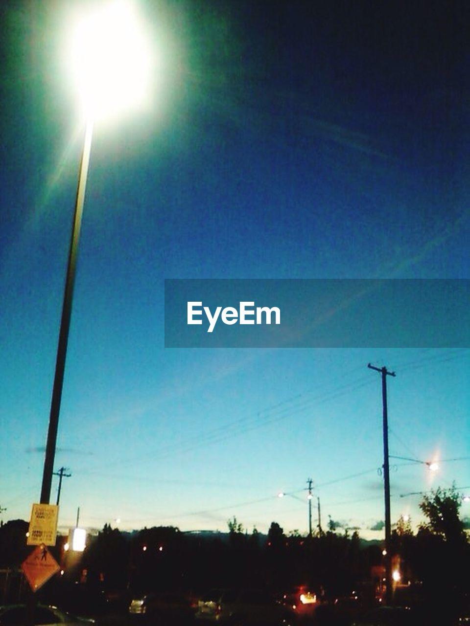 illuminated, street light, sky, outdoors, night, dusk, silhouette, no people, blue, sunset, clear sky, tree, nature, city