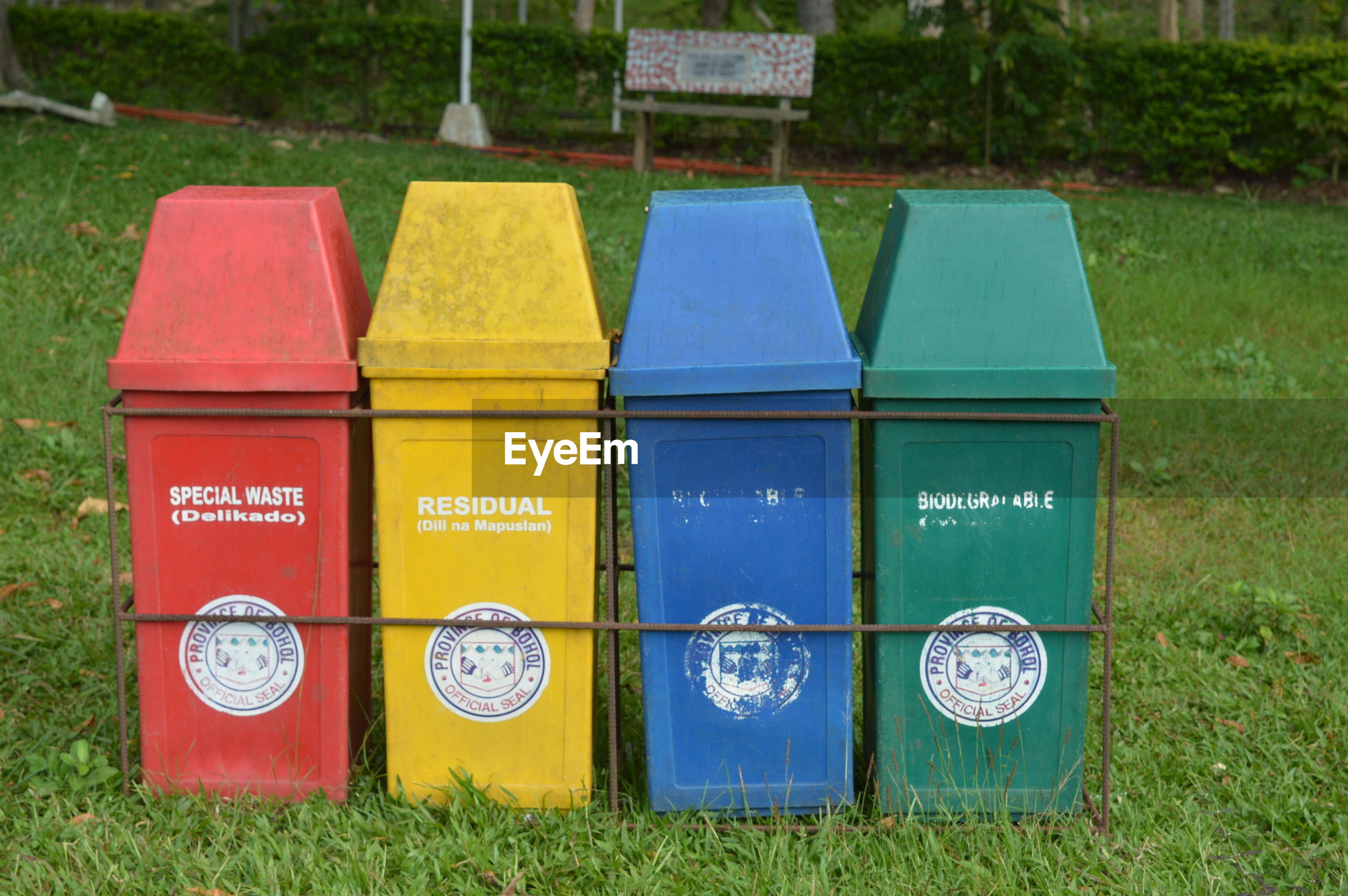 Four trash bins on grass