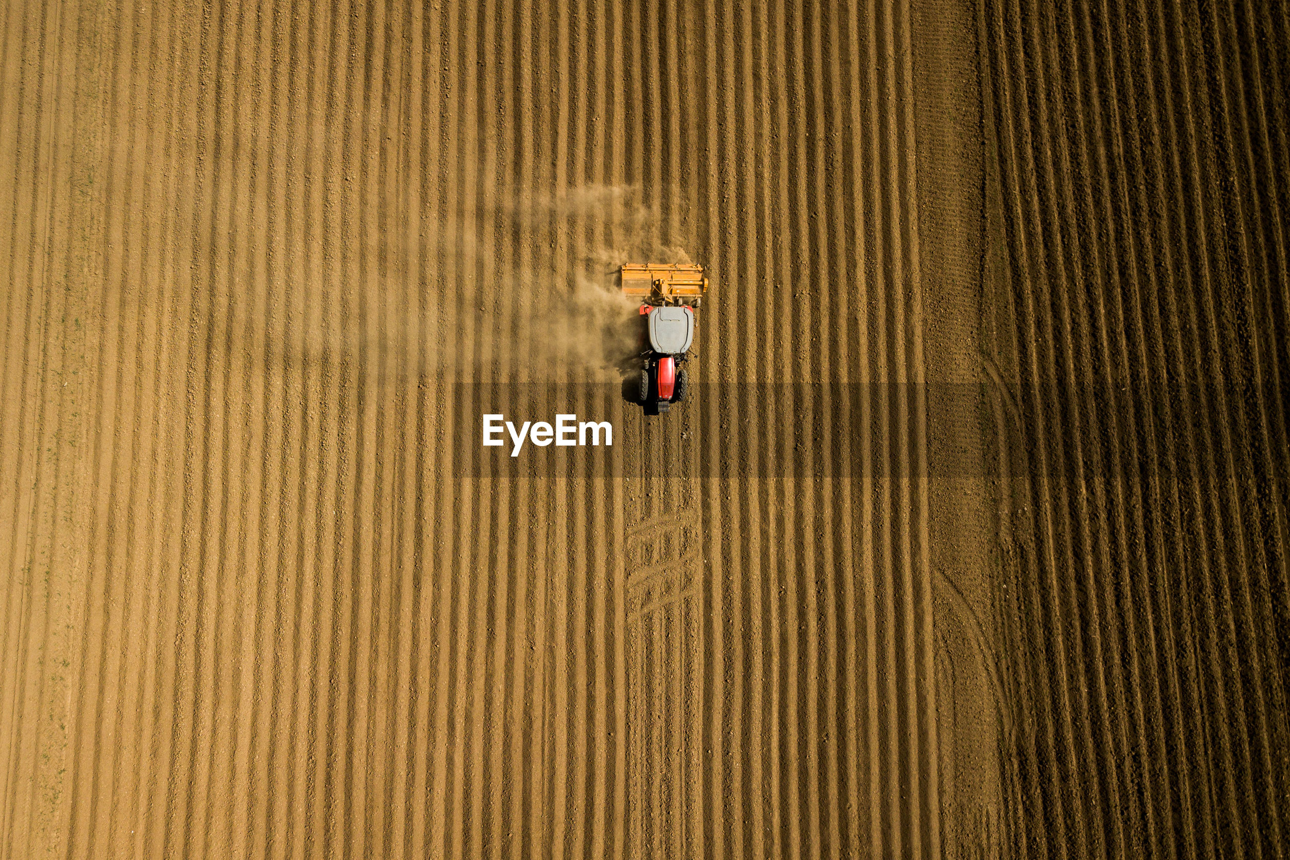 Aerial view of tractor moving on field