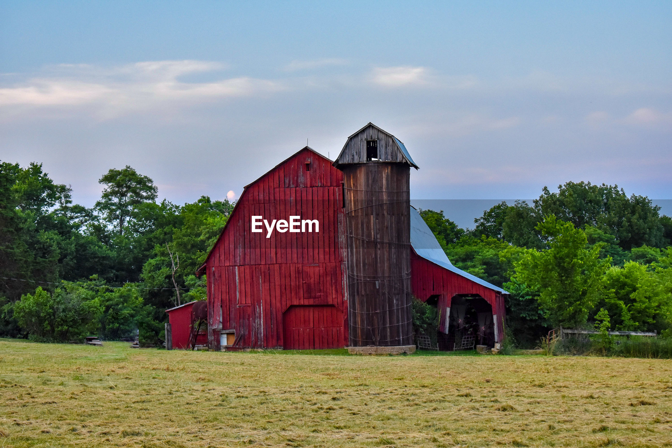 High angle view of barn on grassy field against sky