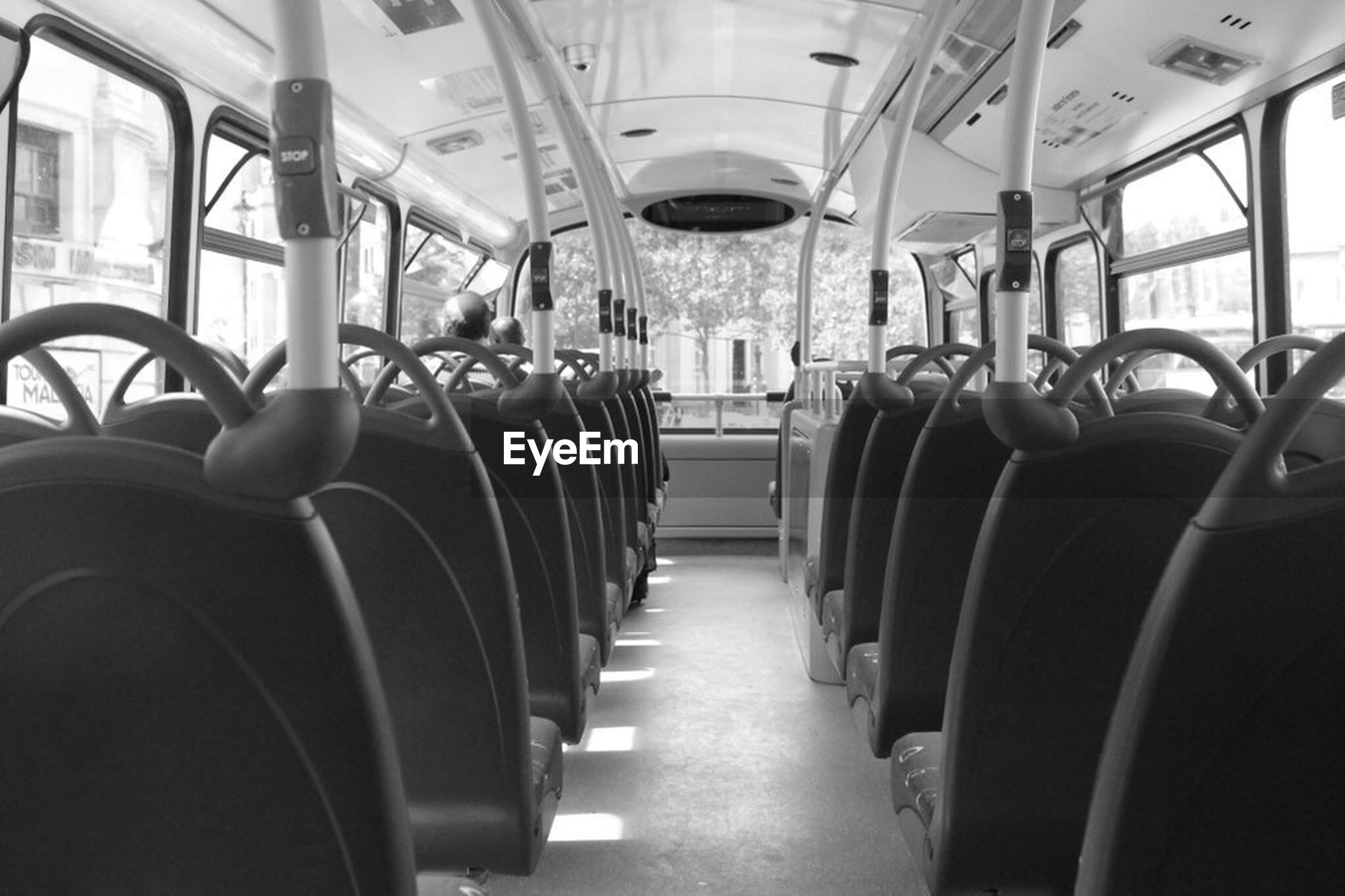 mode of transport, transportation, vehicle seat, vehicle interior, seat, window, bus, travel, public transportation, public transport, absence, in a row, rear view, journey, passenger, sitting, close-up, empty, aisle, mid distance, traveling, repetition, diminishing perspective, transport, long, narrow