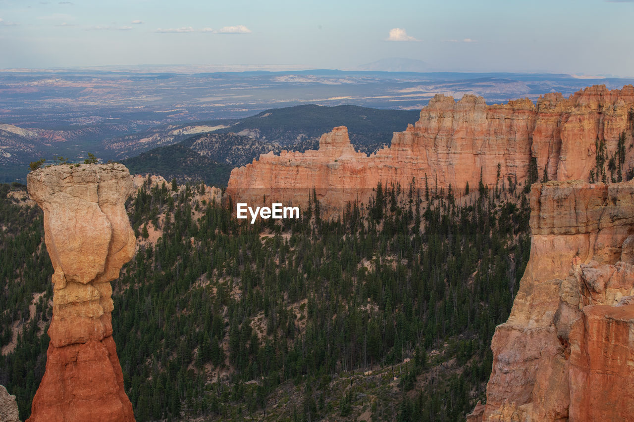 rock formation, rock, sky, travel destinations, travel, canyon, beauty in nature, nature, solid, scenics - nature, mountain, non-urban scene, geology, tranquility, rock - object, physical geography, tranquil scene, no people, tourism, landscape, outdoors, eroded, formation
