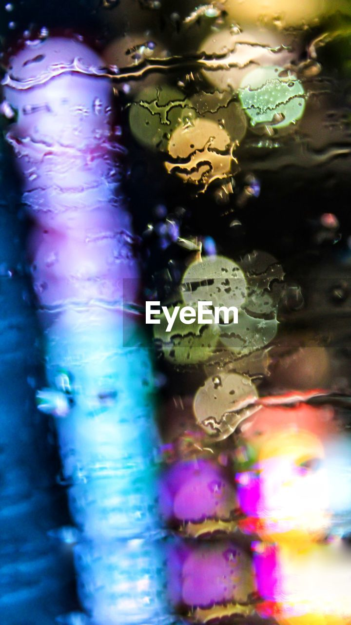 water, multi colored, no people, close-up, indoors, selective focus, wet, full frame, nature, art and craft, animal themes, backgrounds, animal wildlife, pattern, drop, animal, creativity, shape, purple, marine