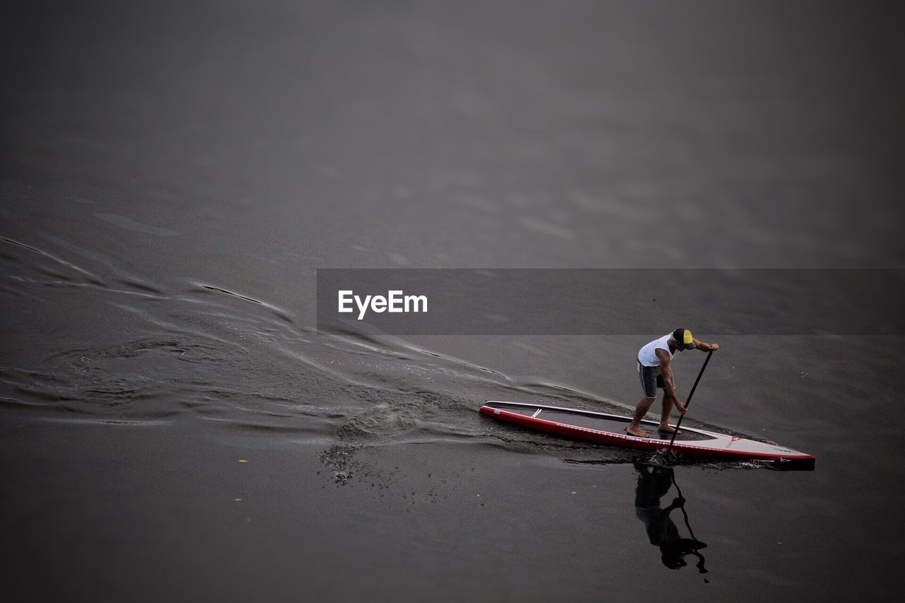 transportation, water, real people, nautical vessel, oar, one person, mode of transport, nature, day, men, outdoors, rowing, people
