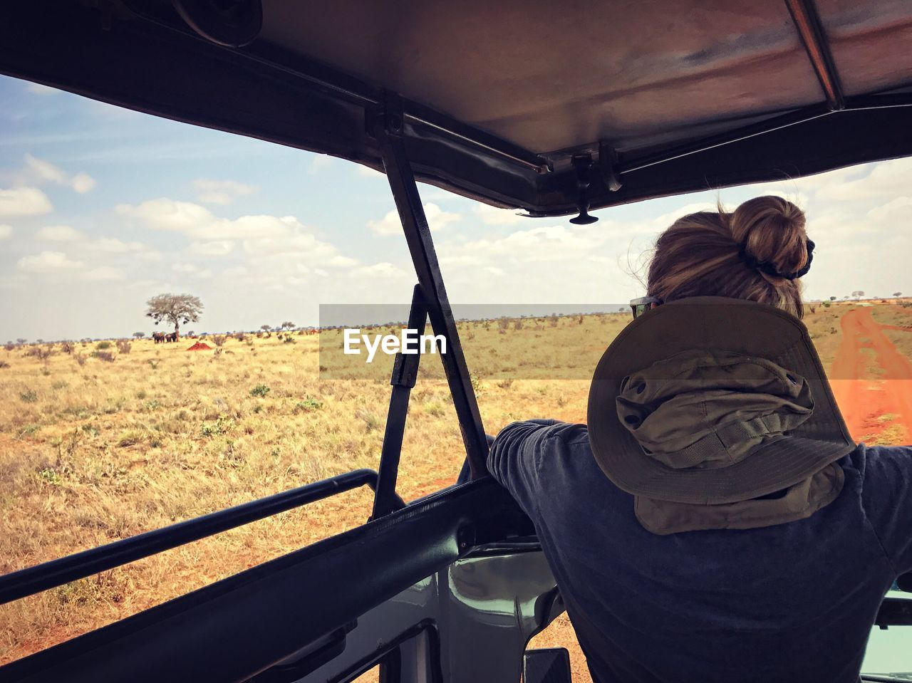 Rear View Of Woman In Off-Road Vehicle At Tsavo East National Park