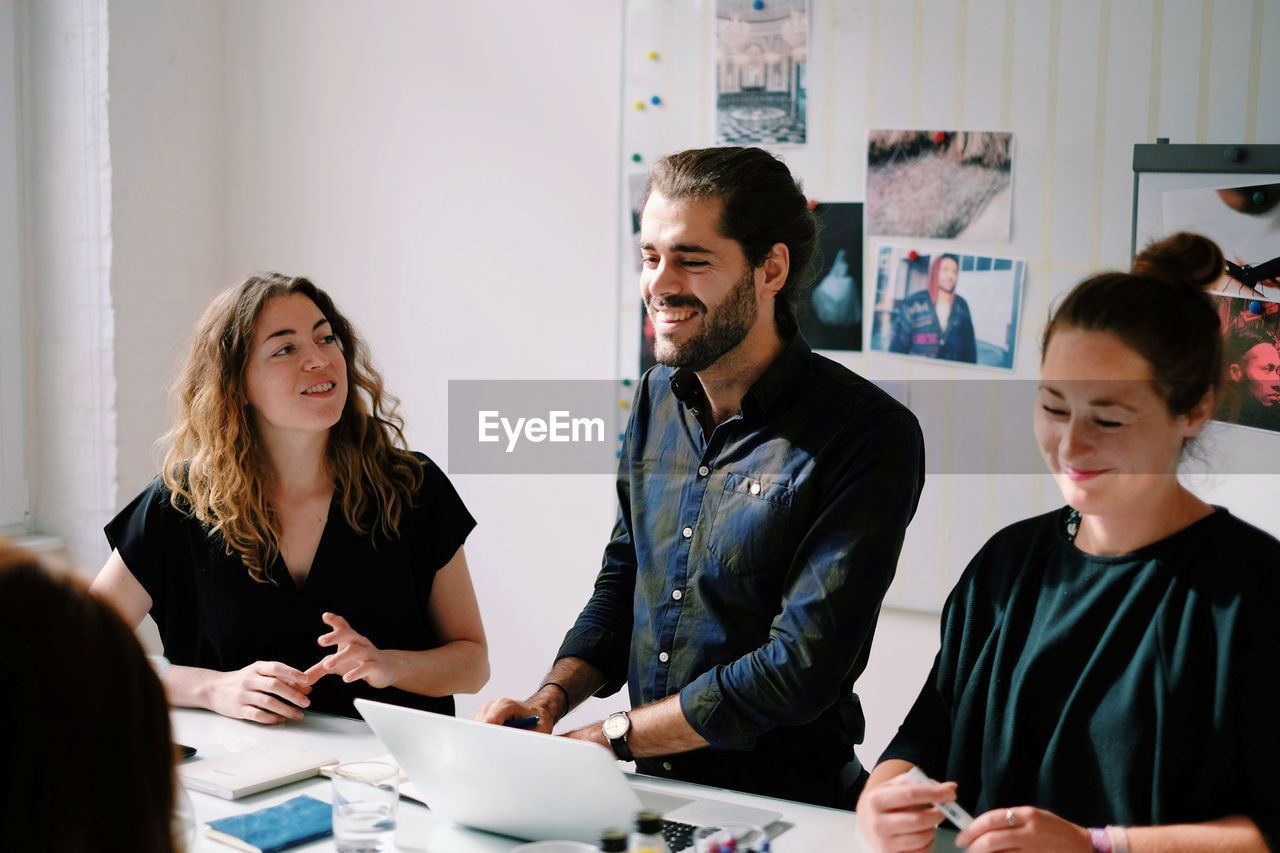 View of people in office meeting