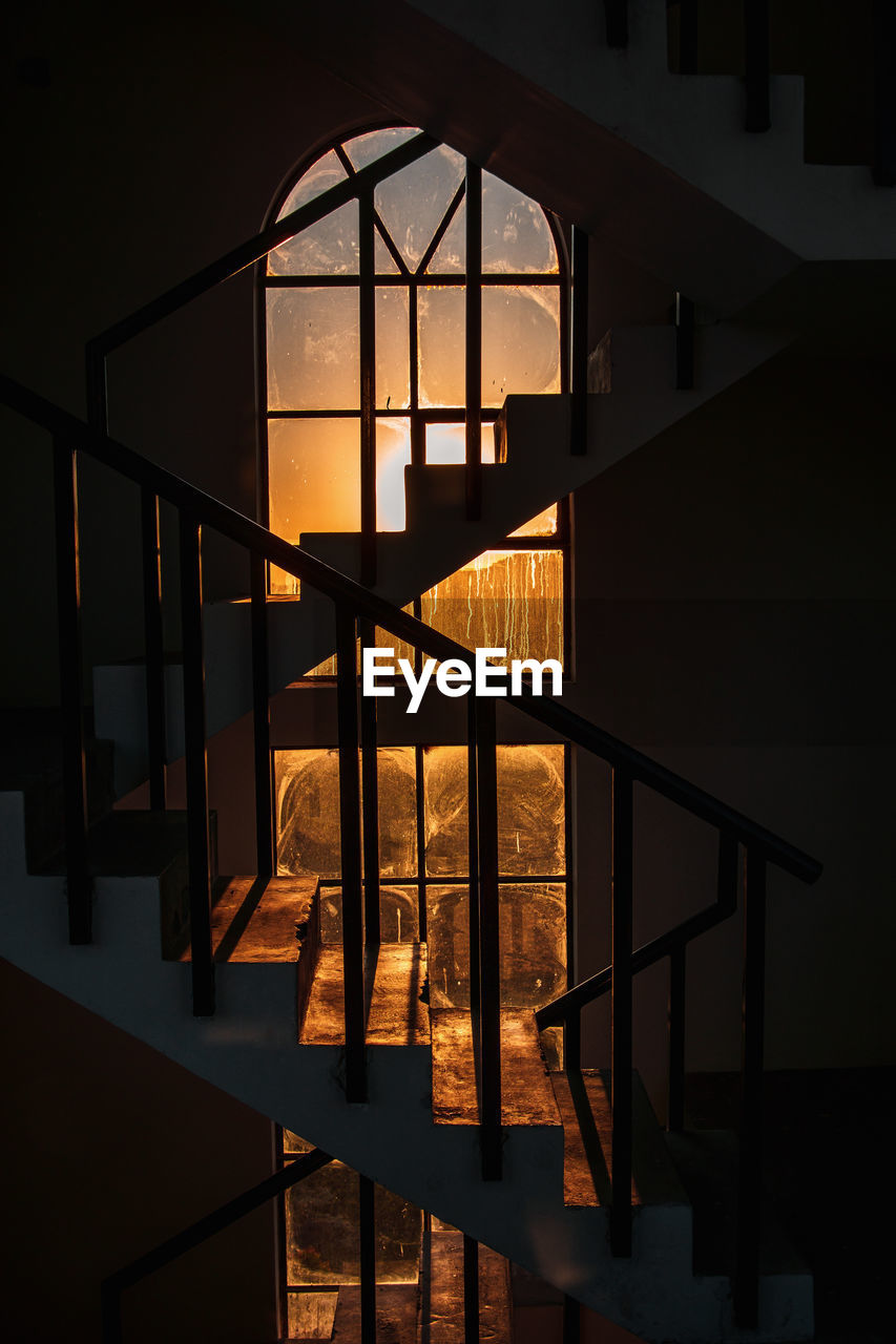 Staircase In Dark Building During Sunset