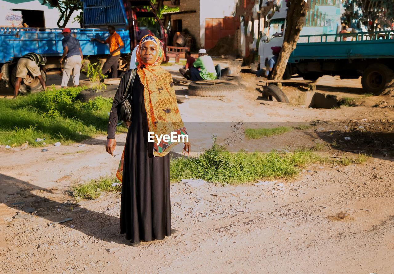 WOMAN STANDING ON STREET
