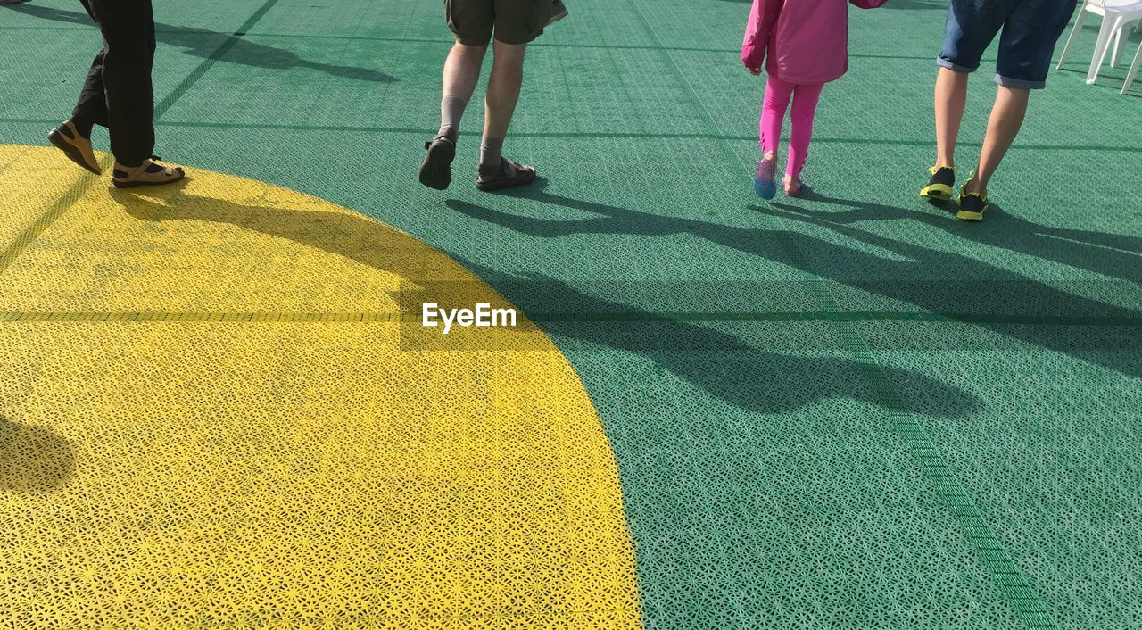Low Section Of People Walking On Ferry Deck