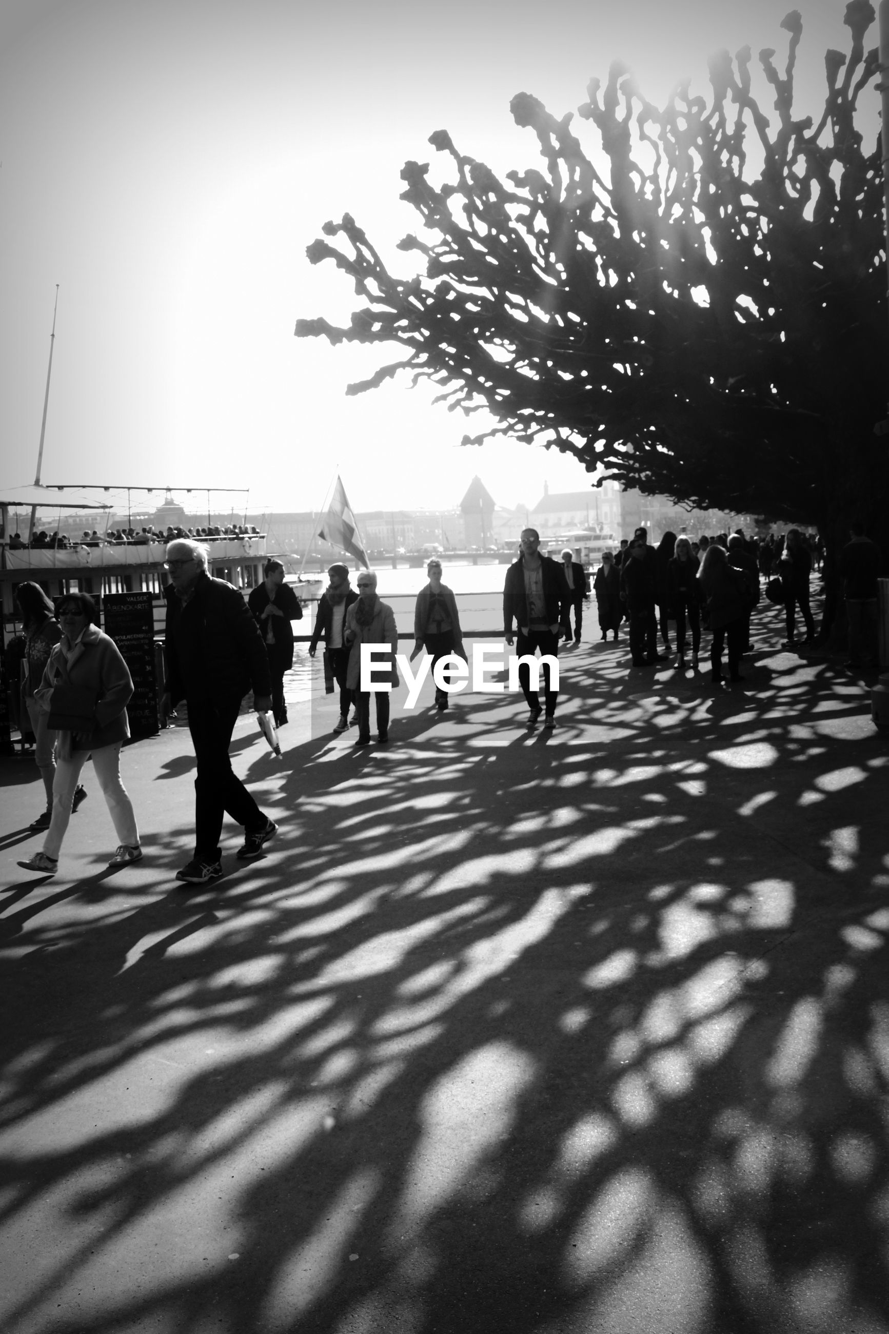 People walking on footpath during sunny day