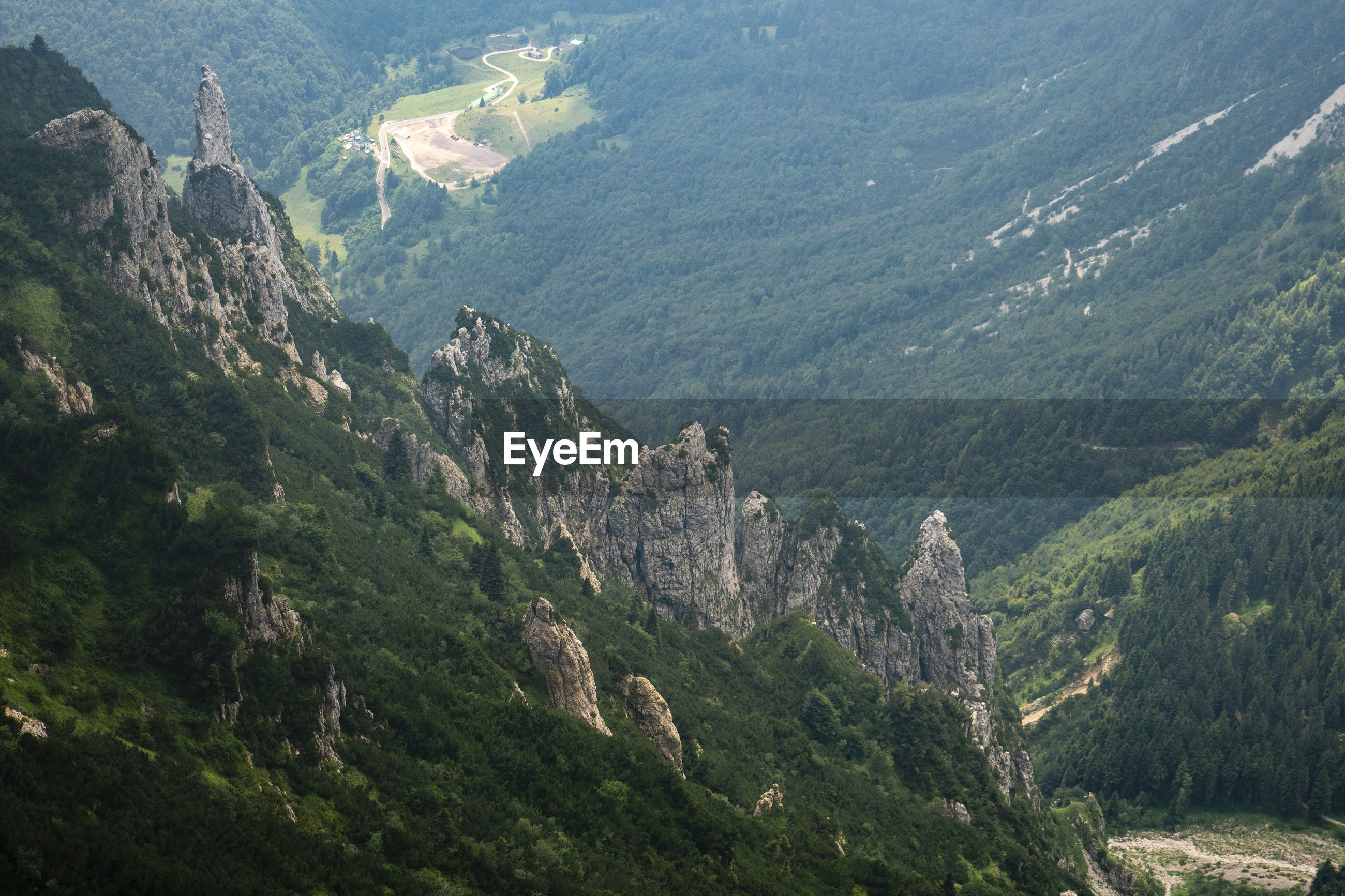 HIGH ANGLE VIEW OF VALLEY AND MOUNTAIN RANGE