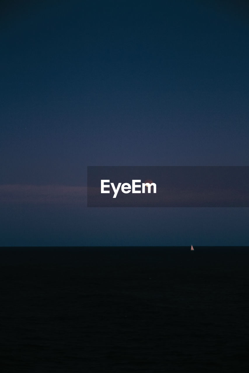 sky, beauty in nature, scenics - nature, tranquil scene, tranquility, horizon, horizon over water, moon, copy space, space, sea, no people, idyllic, nature, water, sunset, astronomy, non-urban scene, land, outdoors, planetary moon, moonlight