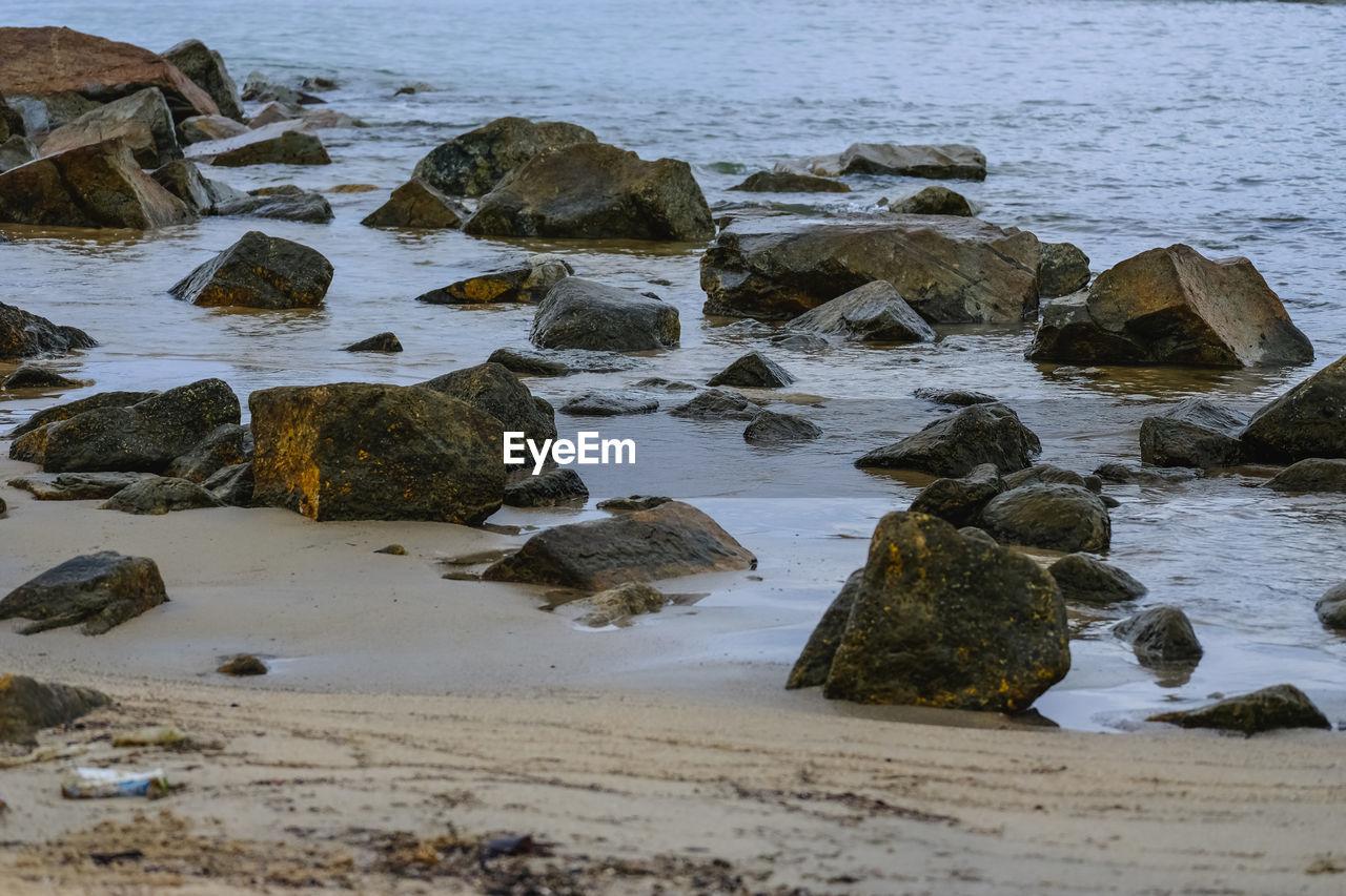 Rocks on shore at sea