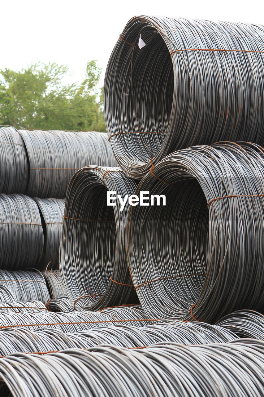industry, metal, pipe - tube, steel, no people, alloy, day, rolled up, factory, stack, sky, metal industry, pattern, bundle, architecture, in a row, silver colored, nature, large group of objects, pipeline
