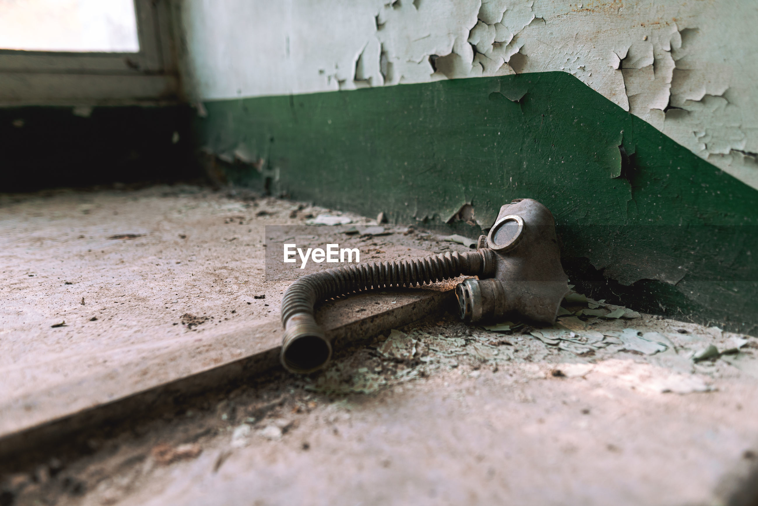 Close-up of old gas mask on floor