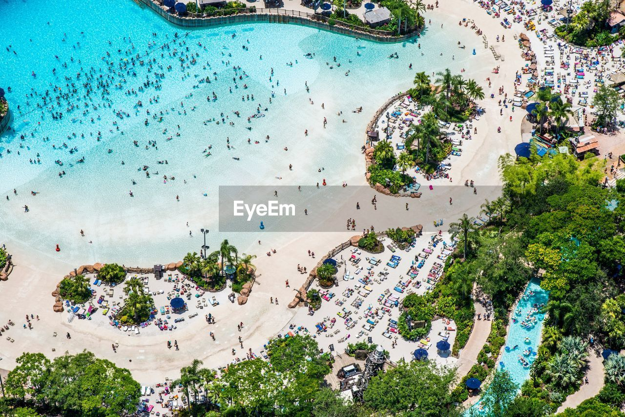 aerial view, high angle view, city, day, outdoors, tree, cityscape, beach, landscape, architecture, scenics, no people, building exterior, nature, sky