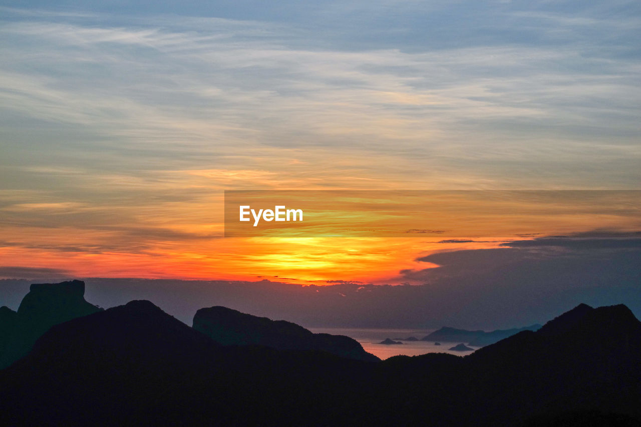 sunset, beauty in nature, scenics, nature, tranquil scene, sky, silhouette, tranquility, no people, mountain, cloud - sky, outdoors, day