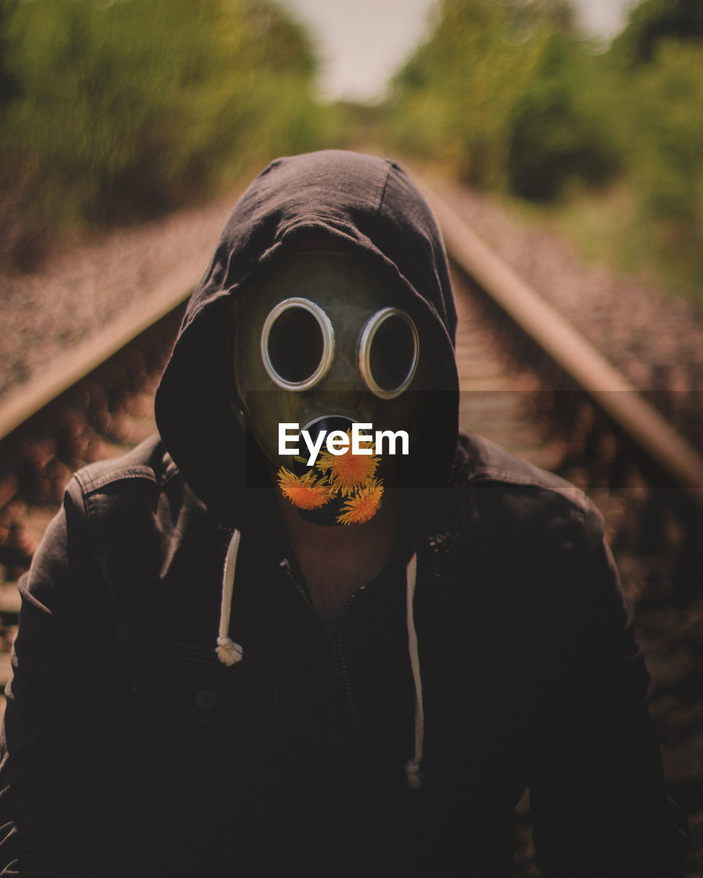 portrait, real people, one person, men, nature, focus on foreground, unrecognizable person, leisure activity, waist up, lifestyles, mask, land, front view, railroad track, clothing, disguise, looking at camera, track, day, outdoors, obscured face, hood - clothing