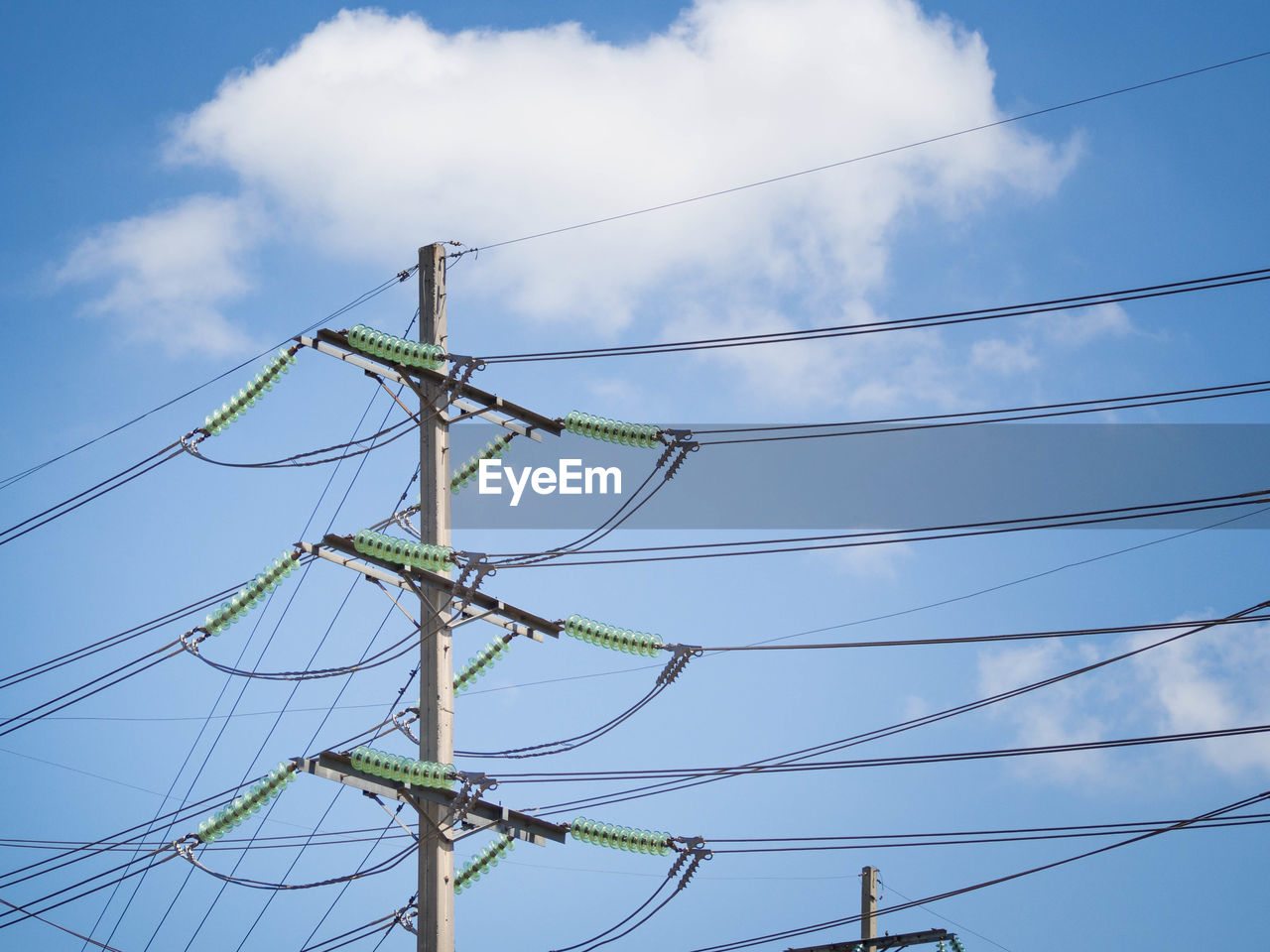 sky, low angle view, cable, electricity, cloud - sky, connection, power line, power supply, complexity, technology, day, fuel and power generation, nature, no people, electricity pylon, blue, outdoors, telephone pole, telephone line, pole, tangled, electrical equipment, chaos