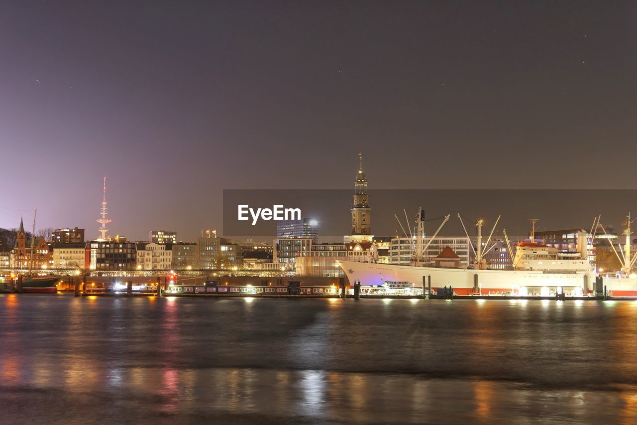 illuminated, water, waterfront, sky, architecture, night, nautical vessel, transportation, reflection, building exterior, built structure, sea, no people, city, harbor, commercial dock, mode of transportation, nature, outdoors