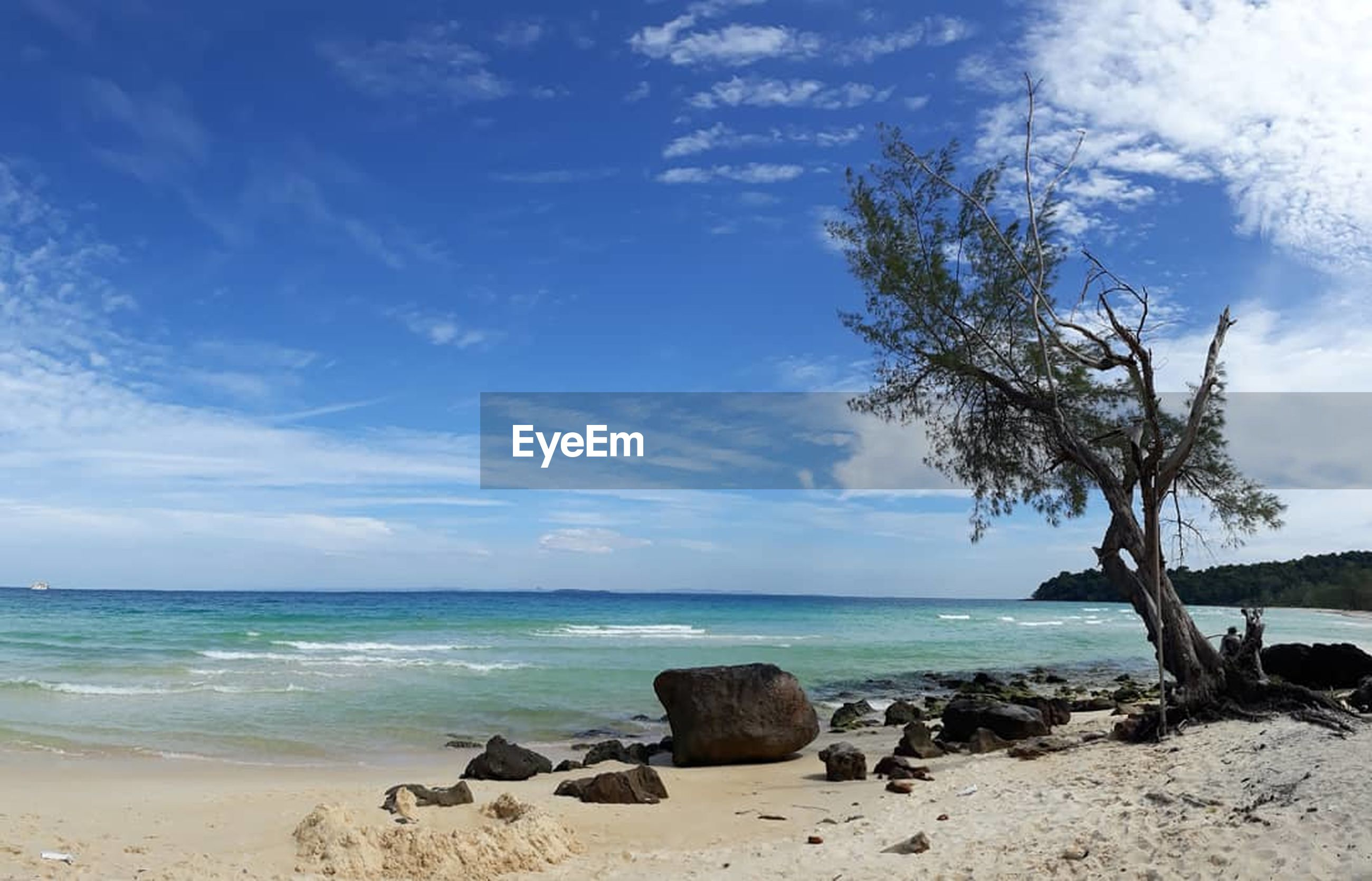 sea, sky, horizon over water, beauty in nature, nature, scenics, water, blue, tranquility, rock - object, cloud - sky, day, outdoors, tranquil scene, beach, no people, tree