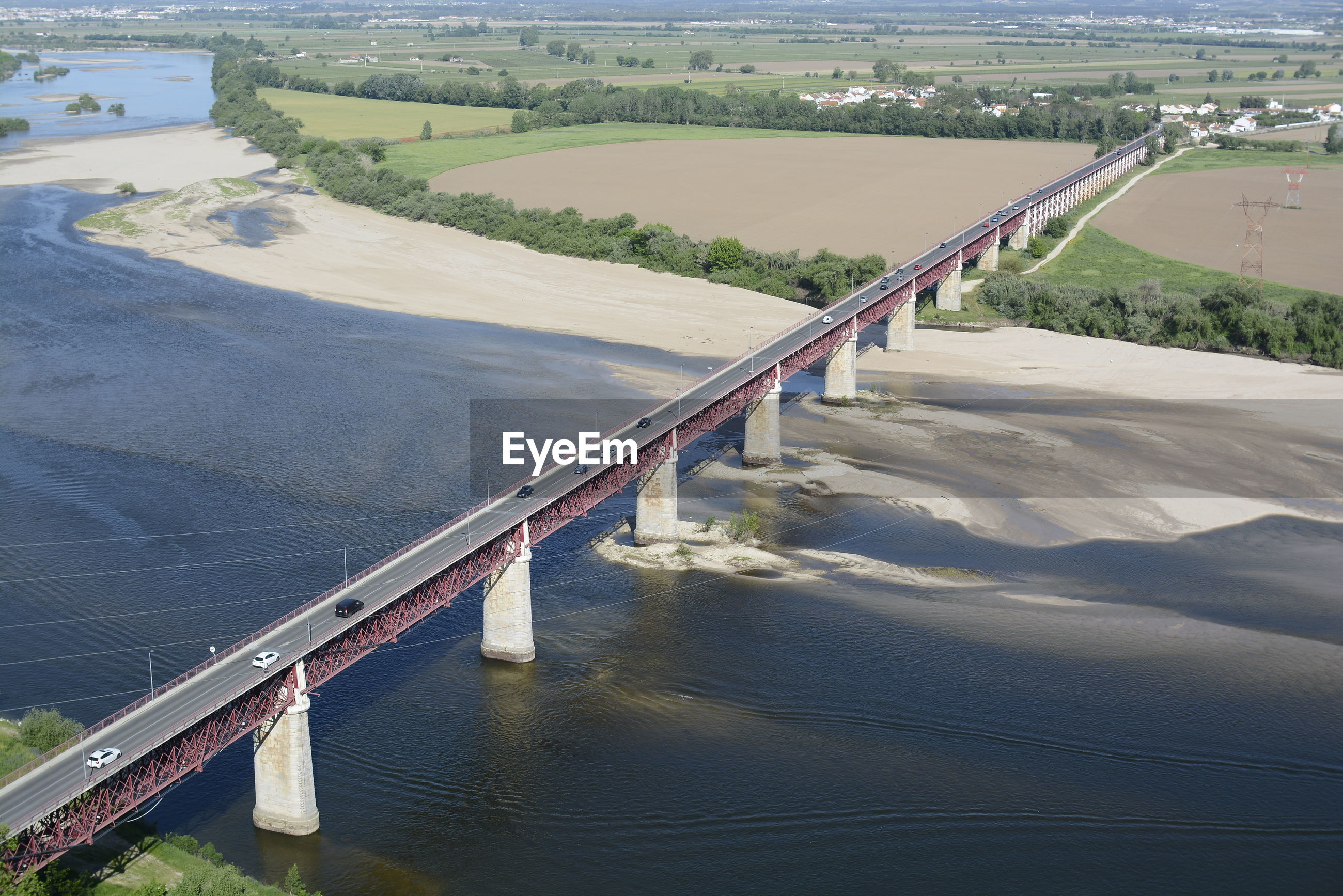 HIGH ANGLE VIEW OF BRIDGE OVER RIVER BY LANDSCAPE