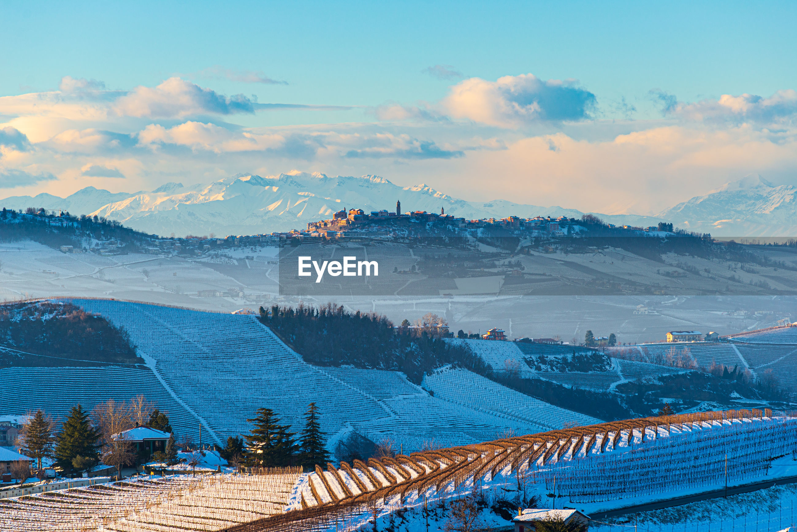 HIGH ANGLE VIEW OF SNOWCAPPED MOUNTAIN AGAINST SKY DURING WINTER