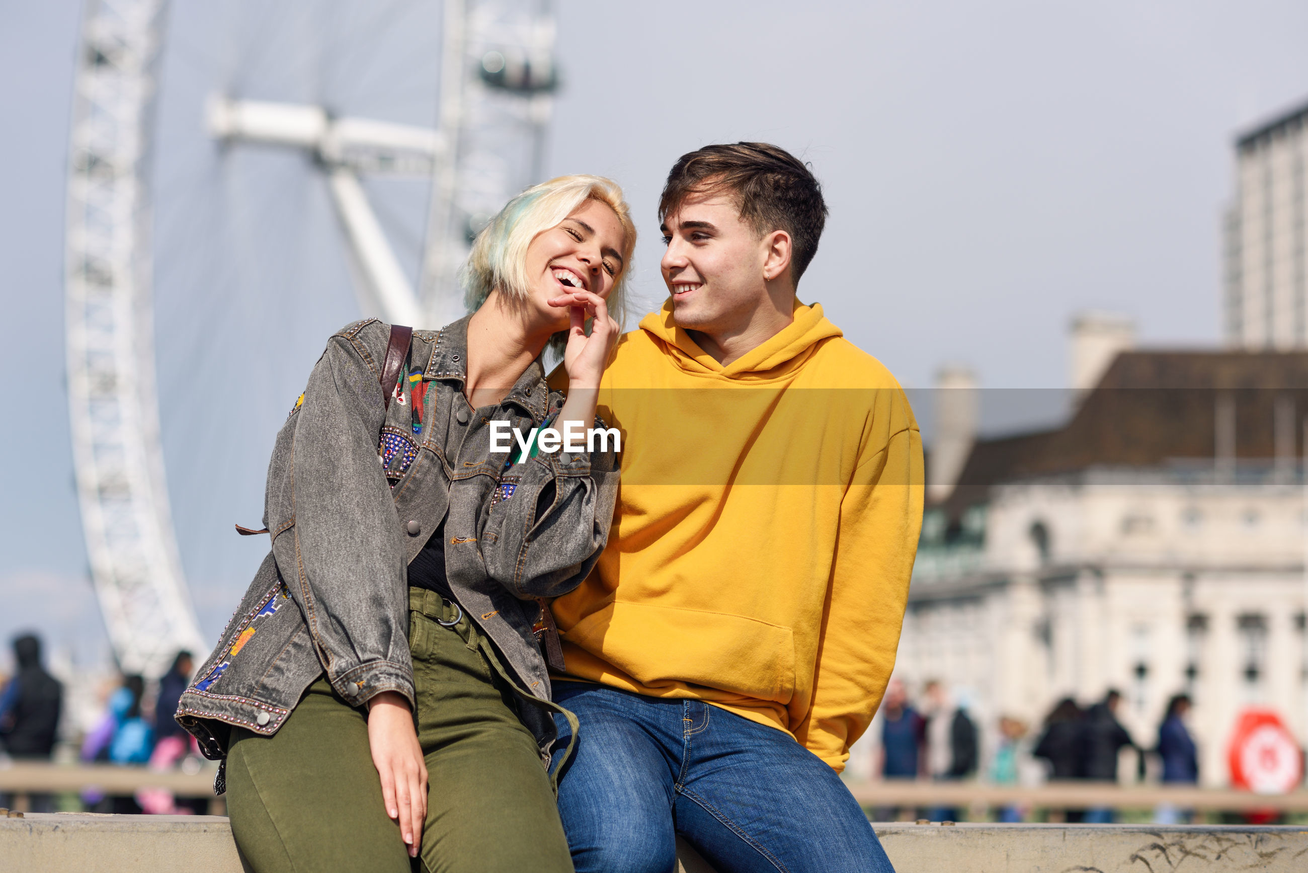 Smiling couple talking in city