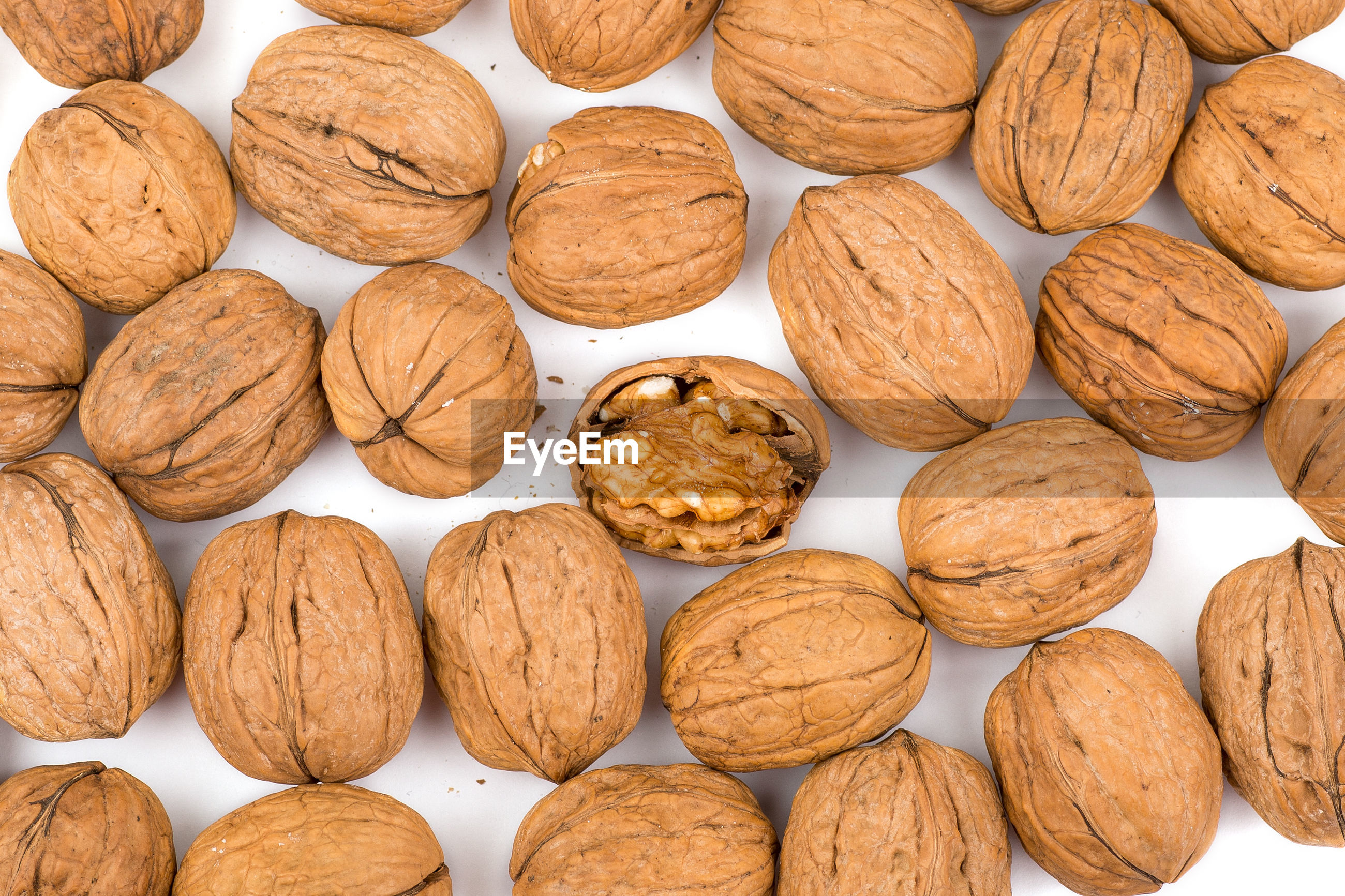 Full frame shot of walnuts on table
