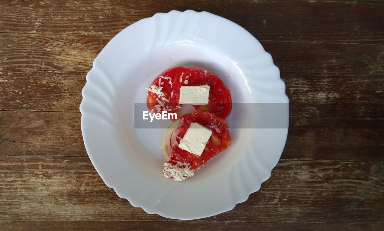 plate, food and drink, directly above, sweet food, still life, table, food, indulgence, no people, freshness, indoors, high angle view, unhealthy eating, dessert, cake, ready-to-eat, serving size, red, temptation, cheesecake, close-up, paper plate, day
