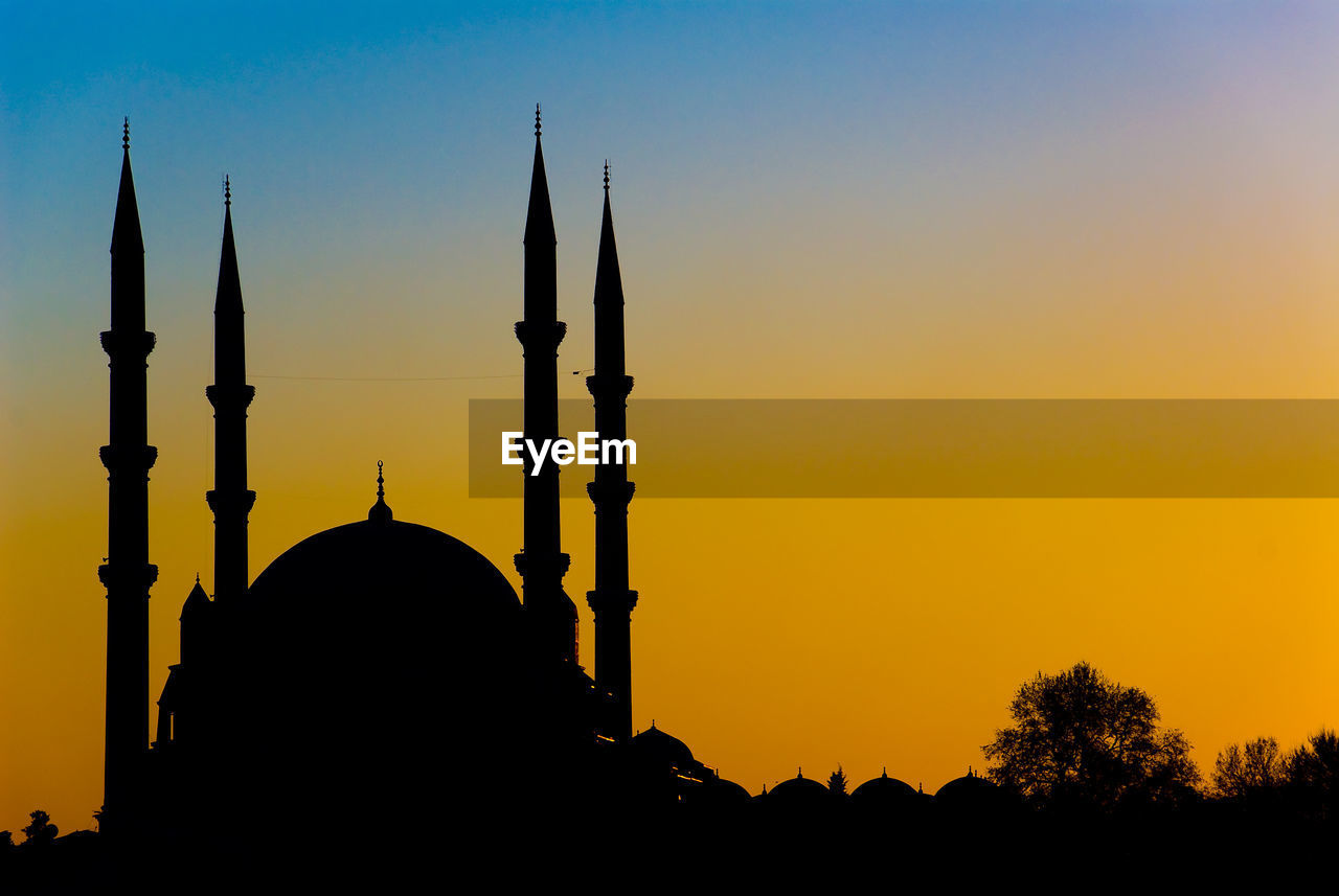 silhouette, sky, sunset, architecture, place of worship, religion, built structure, belief, building exterior, no people, nature, dome, spirituality, history, building, the past, orange color, travel destinations, outdoors, spire
