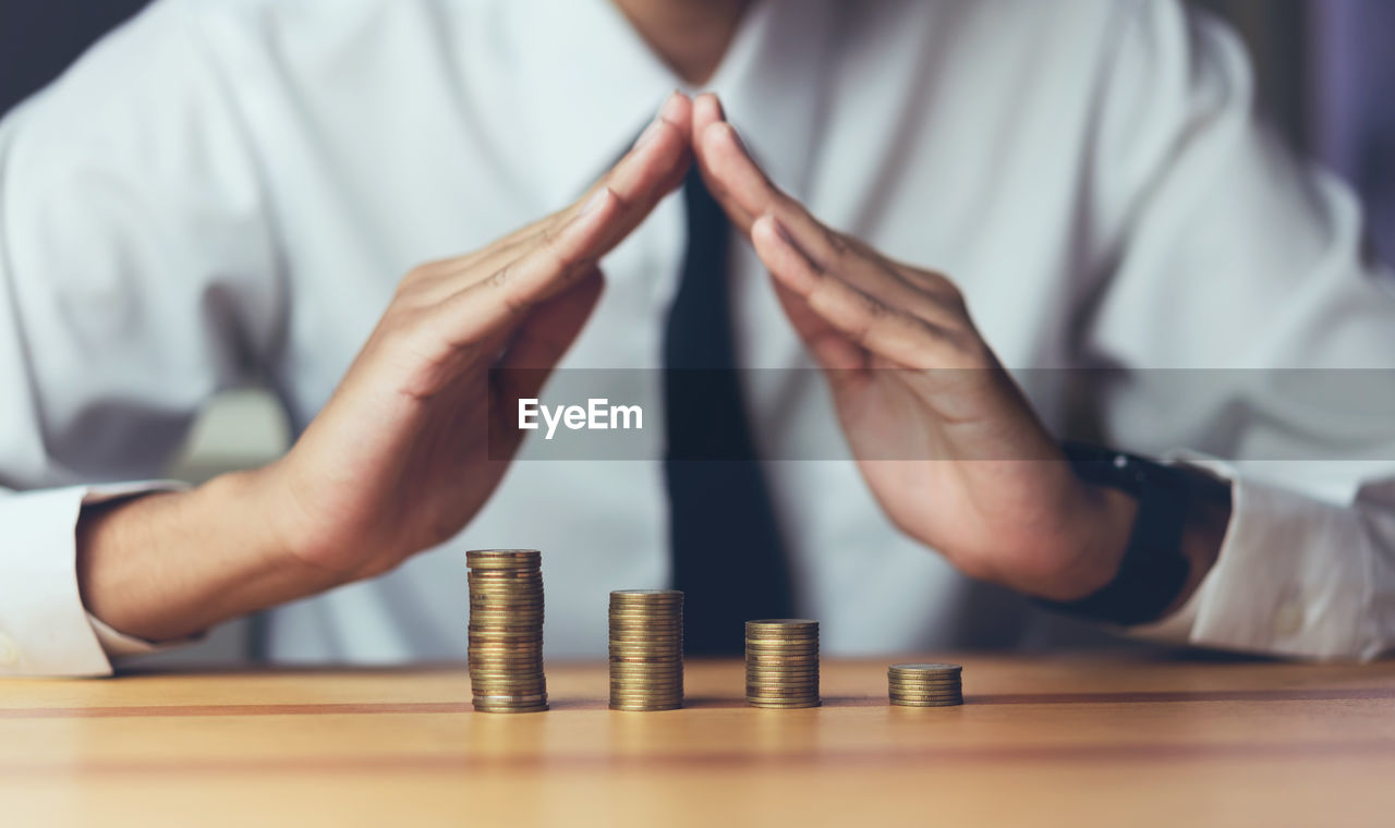 Midsection Of Businessman With Coins