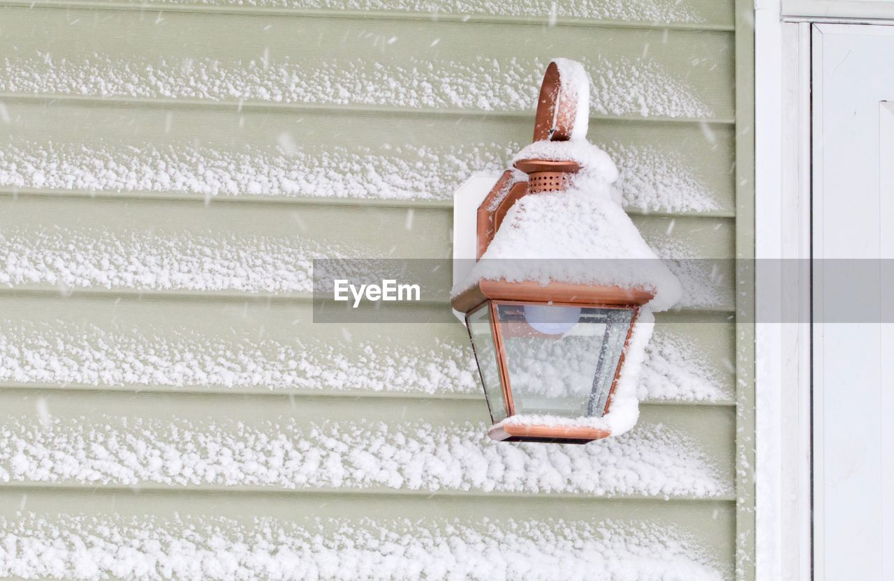 LOW ANGLE VIEW OF SMALL WINDOW IN SNOW