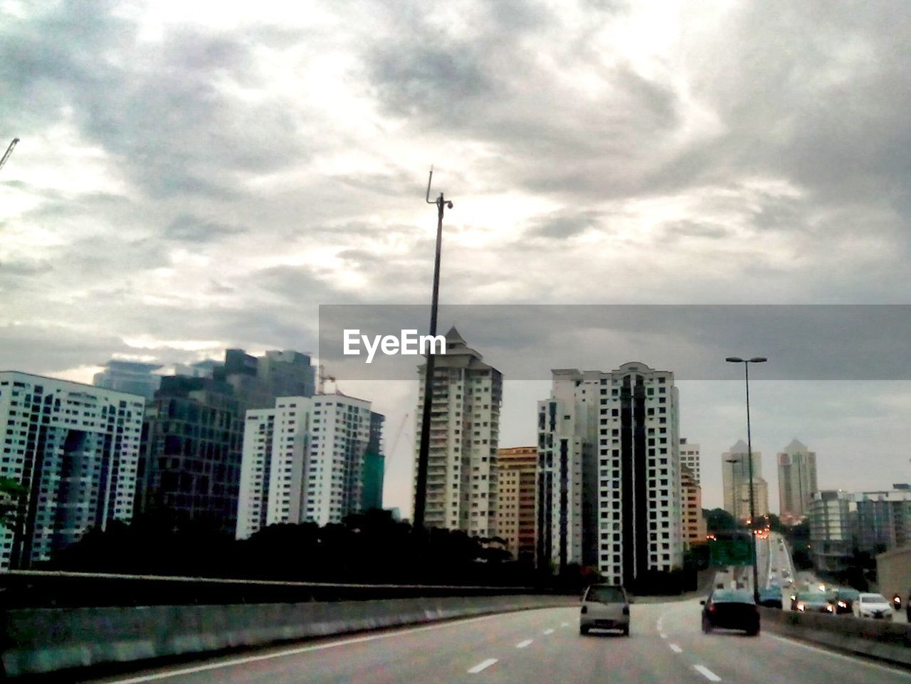 architecture, city, building exterior, built structure, skyscraper, modern, sky, outdoors, cityscape, tall, road, no people, day