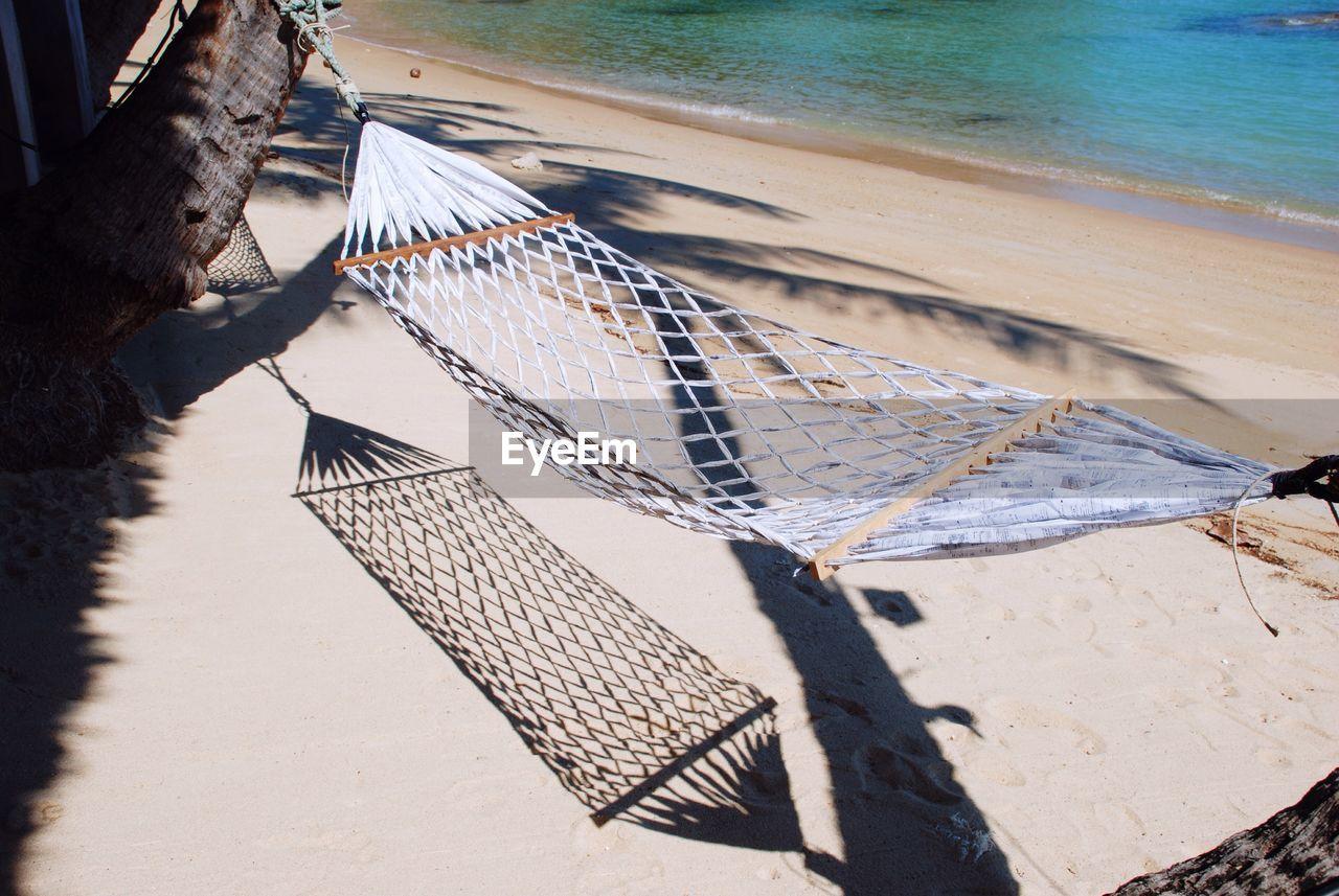 Hammock hanging at beach during sunny day