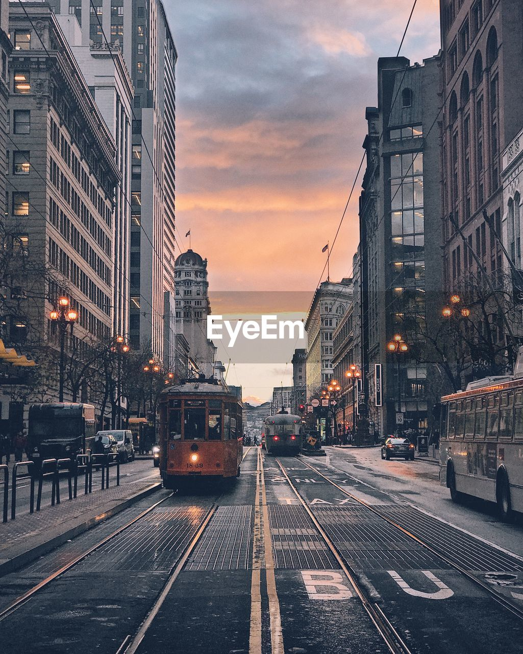 Tramway On Street Against Cloudy Sky During Sunset