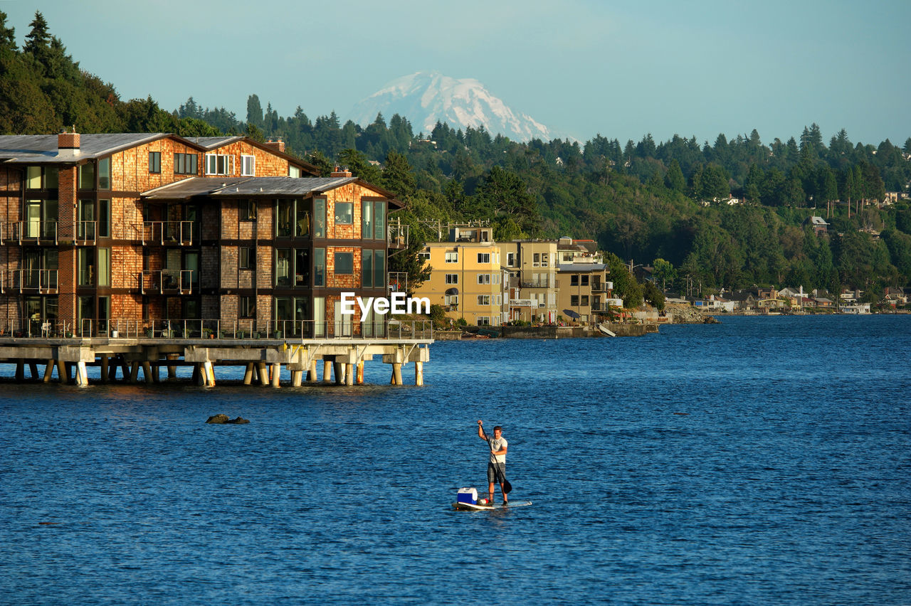 High angle view of man paddleboarding in sea