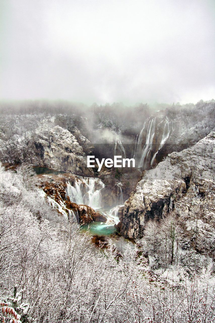 Aerial view of snow covered waterfall