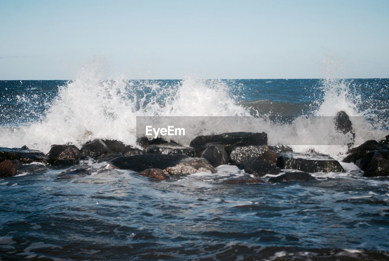sea, water, motion, power in nature, wave, power, sky, beauty in nature, rock, crash, splashing, breaking, nature, force, no people, day, hitting, rock - object, sport, horizon over water, outdoors