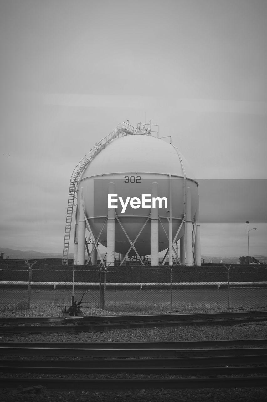 Storage tank against sky