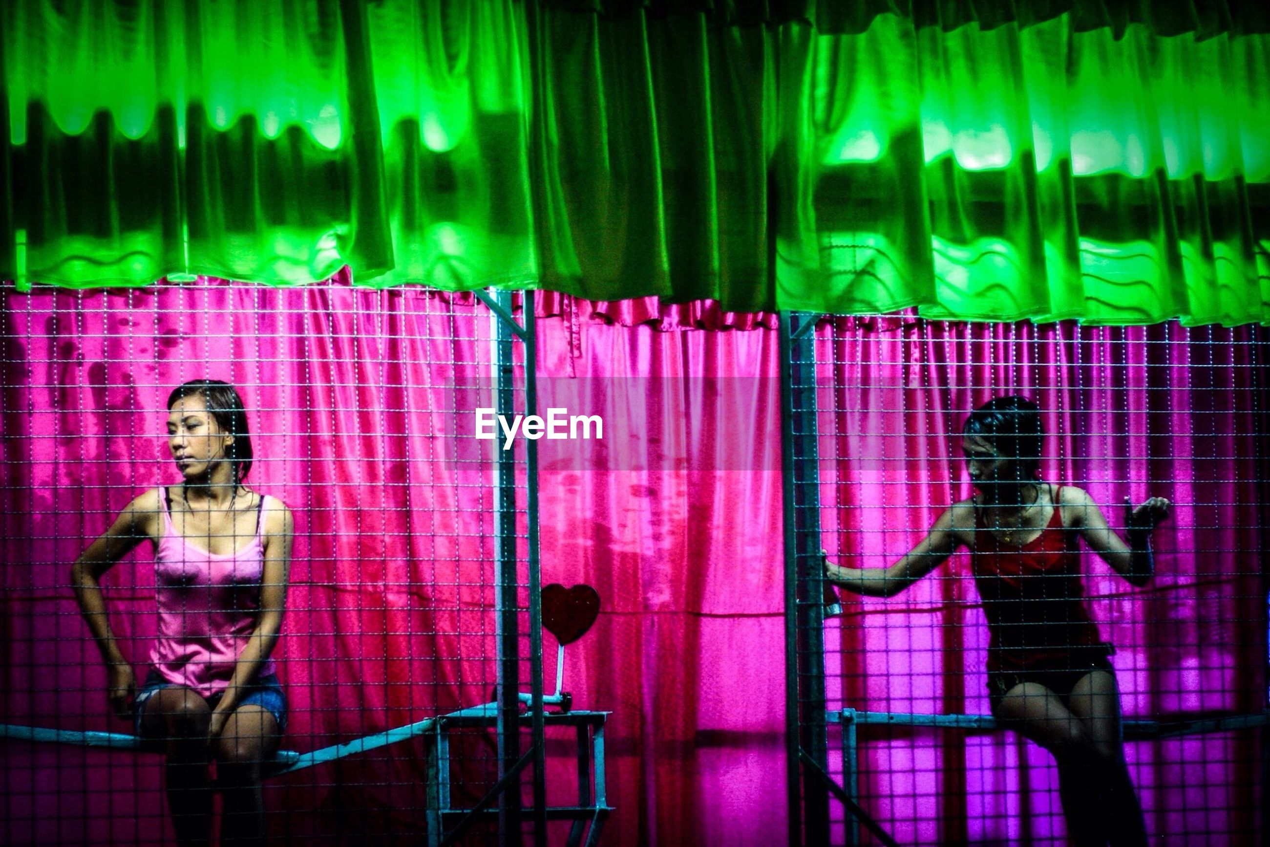 green color, purple, adults only, multi colored, adult, indoors, pink color, illuminated, technology, standing, people, night, young adult, only women, one person, one woman only, neon